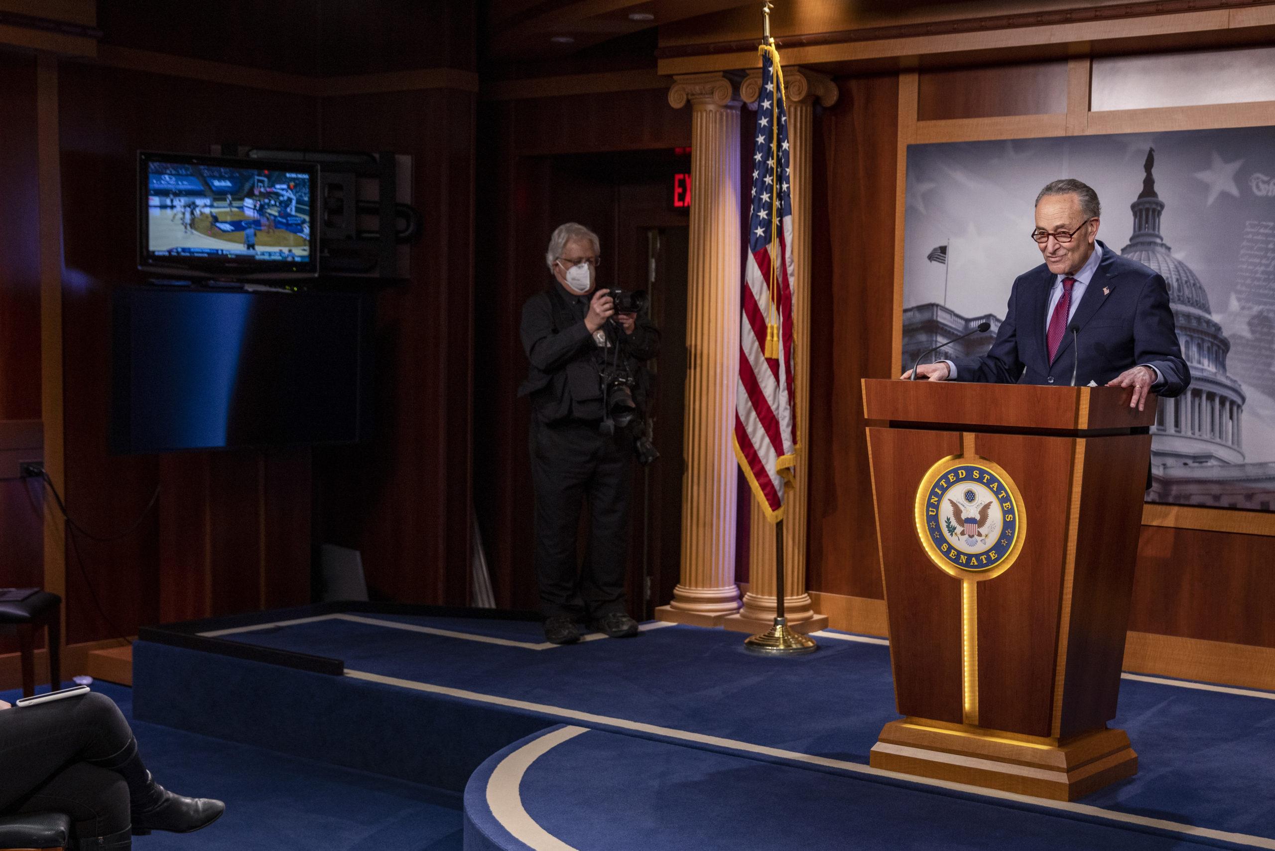 Senate Majority Leader Chuck Schumer speaks to reporters Saturday after the Senate passed the $1.9 trillion coronavirus stimulus package. (Tasos Katopodis/Getty Images)