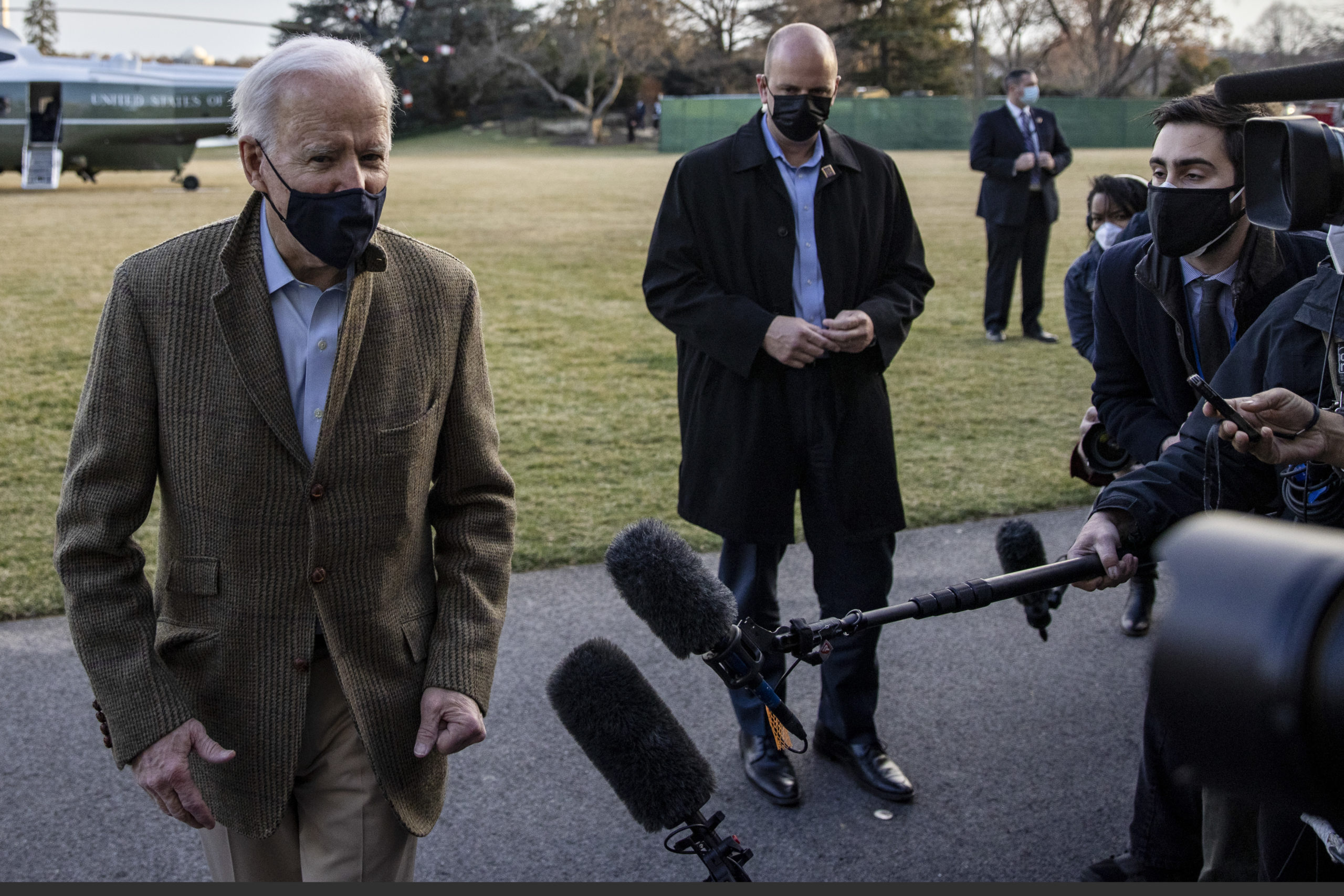 WASHINGTON, DC - MARCH 14: U.S. President Joe Biden stops to talk to the media after stepping off Marine One on the South Lawn of the White House on March 14, 2021 in Washington, DC. President Biden and First Lady Dr. Jill Biden were traveling from Wilmington, Delaware, where they spent the weekend with family and friends. (Photo by Tasos Katopodis/Getty Images)