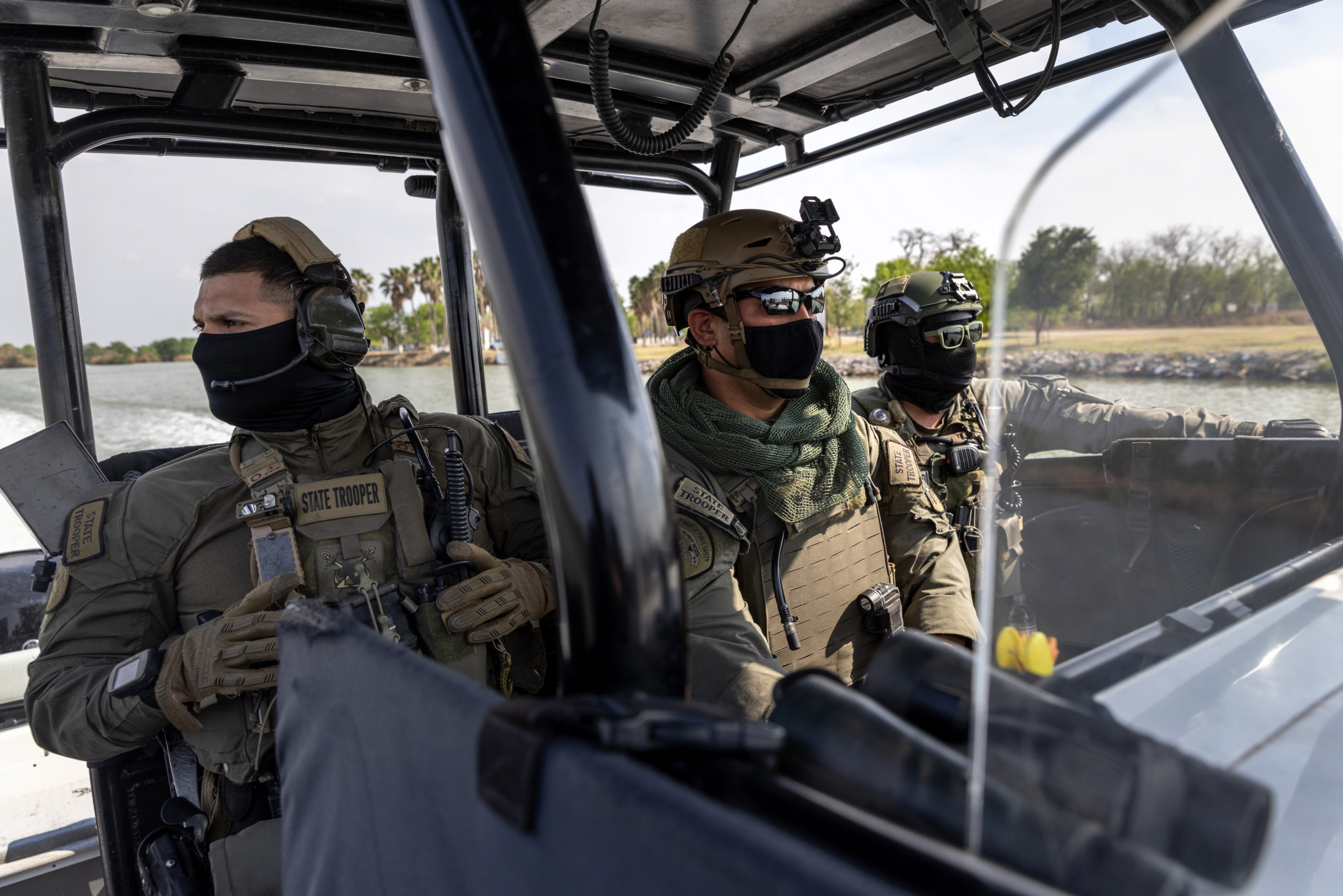 """MISSION, TEXAS - MARCH 23: Members of the Texas Department of Public Safety's Tactical Marine Unit patrol the Rio Grande along the U.S.-Mexico Border on March 23, 2021 near Mission, Texas. Texas DPS troopers are taking part in Operation Lone Star in supporting U.S. Border Patrol agents to """"deny Mexican Cartels and other smugglers the ability to move drugs and people into Texas."""" A surge of immigrants, including unaccompanied minors crossing into the United States from Mexico is overcrowding processing and detention centers in south Texas. (Photo by John Moore/Getty Images)"""