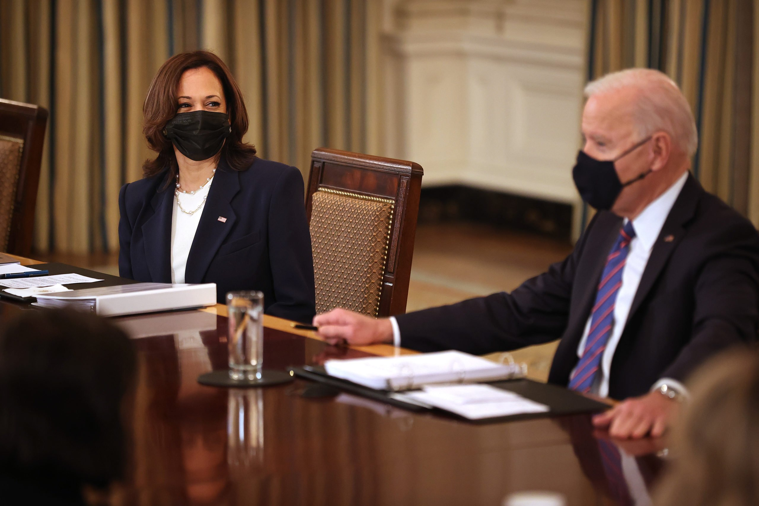 WASHINGTON, DC - MARCH 24: U.S. Vice President Kamala Harris (L) and President Joe Biden meet with cabinet memebrs and immigration advisors in the State Dining Room on March 24, 2021 in Washington, DC. With the number of migrants apprehended at the U.S.-Mexico border reaching a two-decade high, Biden announced that Harris will be leading the White House efforts to handle the crisis at the border. (Photo by Chip Somodevilla/Getty Images)