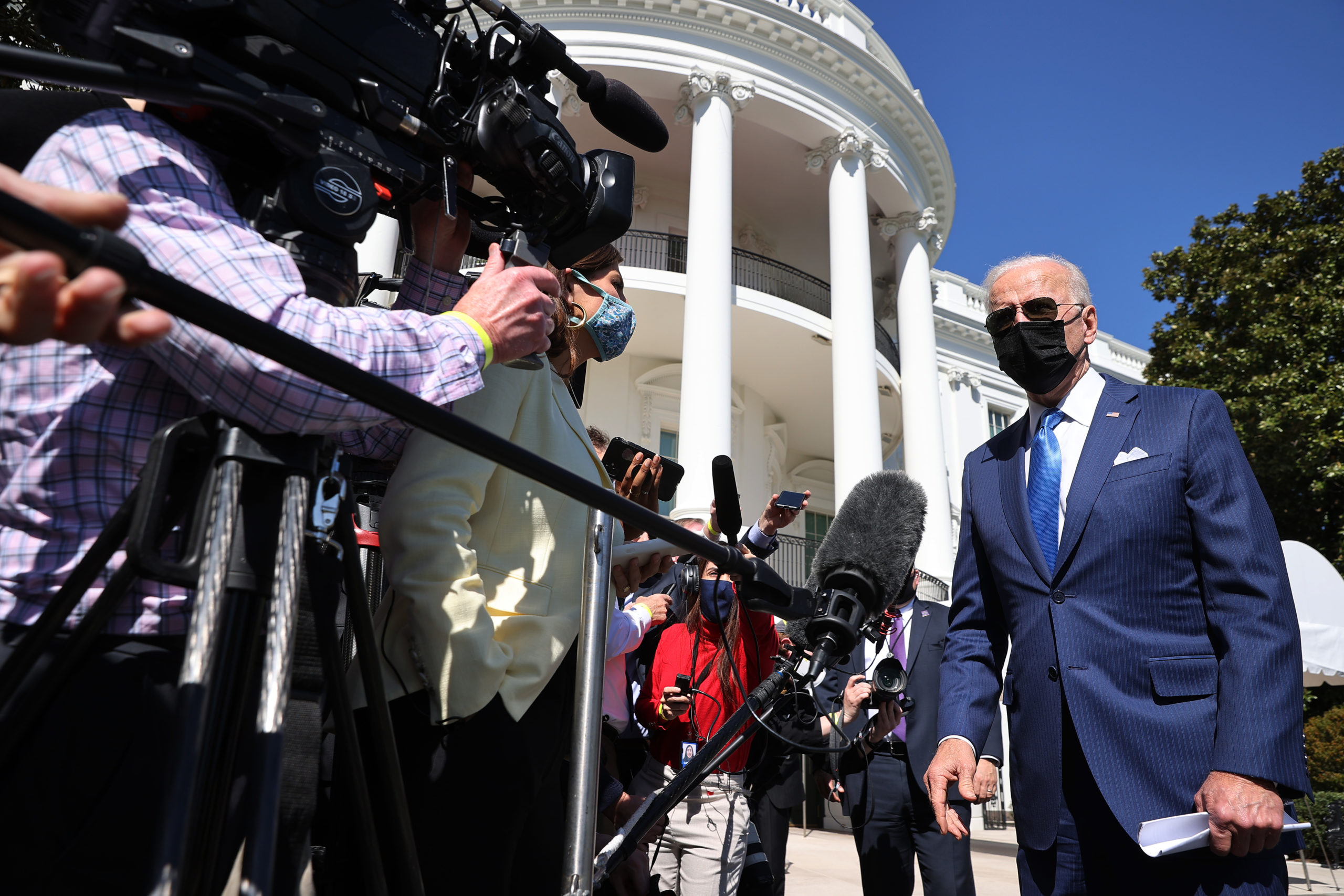 WASHINGTON, DC - MARCH 26: U.S. President Joe Biden talks to reporters as he departs the White House on March 26, 2021 in Washington, DC. Biden is traveling to Wilmington, Delaware, to spend the weekend at home. (Photo by Chip Somodevilla/Getty Images)