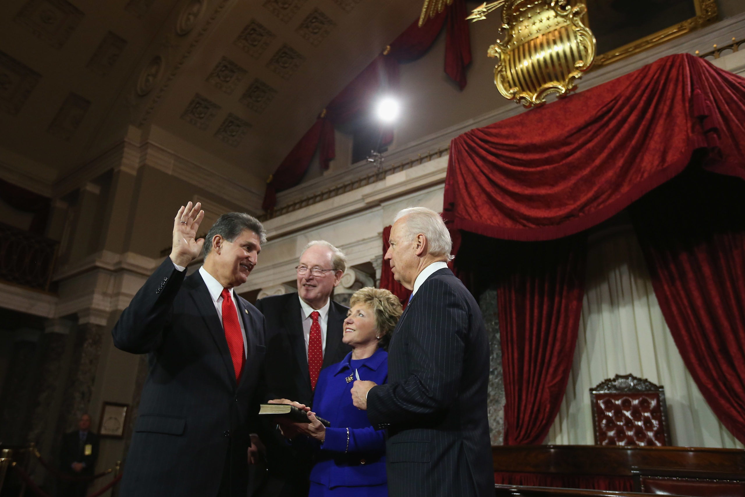 WASHINGTON, DC - JANUARY 03: U.S. Sen. Joe Manchin (D-WV) (L) participates in a reenacted swearing-in with his wife Gayle Conelly Manchin, U.S. Sen. Jay Rockefeller (D-WV) and U.S. Vice President Joe Biden in the Old Senate Chamber at the U.S. Capitol January 3, 2013 in Washington, DC. Biden swore in the newly-elected and re-elected senators earlier in the day on the floor of the current Senate chamber. (Photo by Chip Somodevilla/Getty Images)
