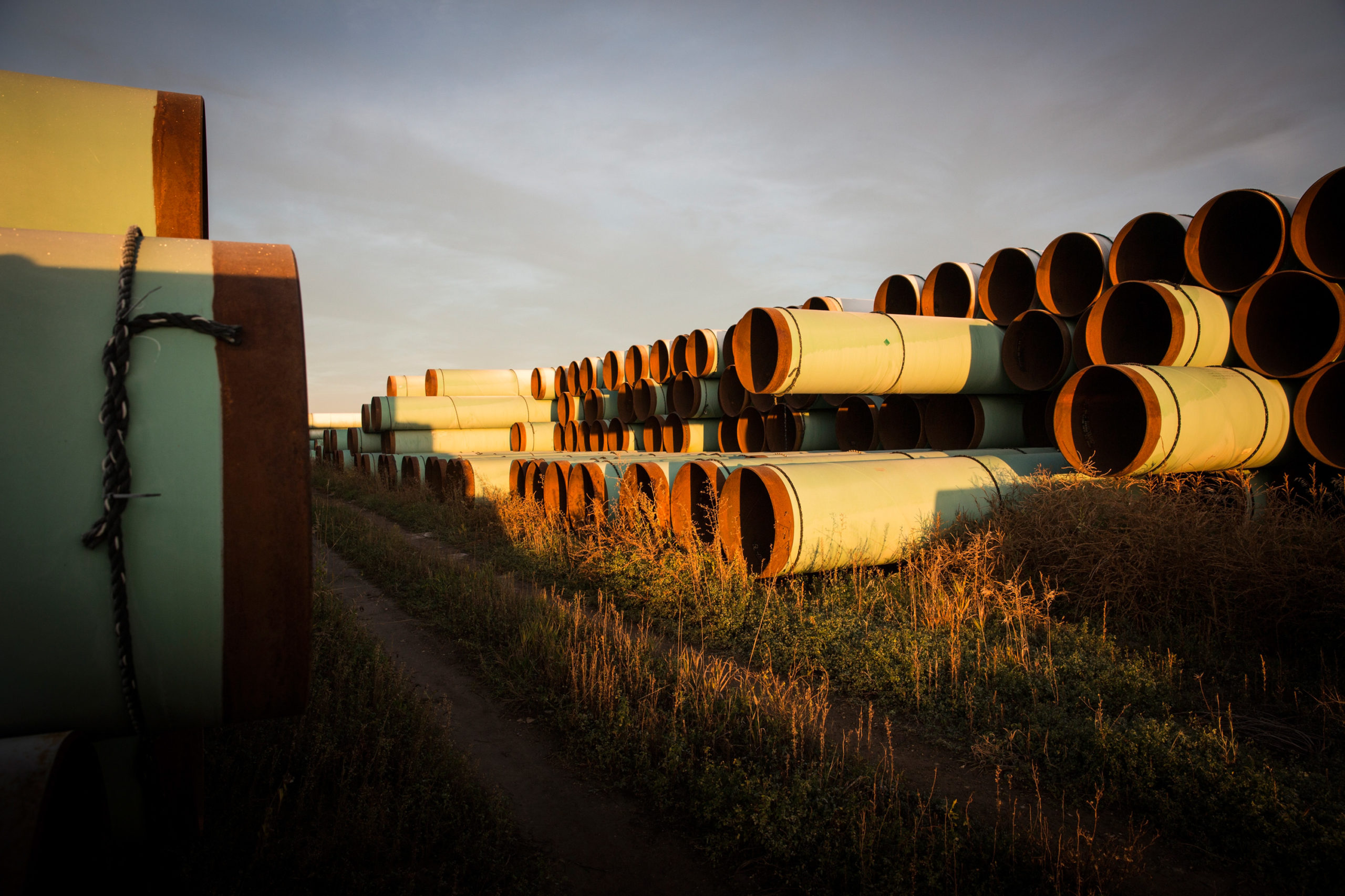 Miles of unused pipe, prepared for the proposed Keystone XL pipeline, sit in a lot in 2014 outside Gascoyne, North Dakota. (Andrew Burton/Getty Images)
