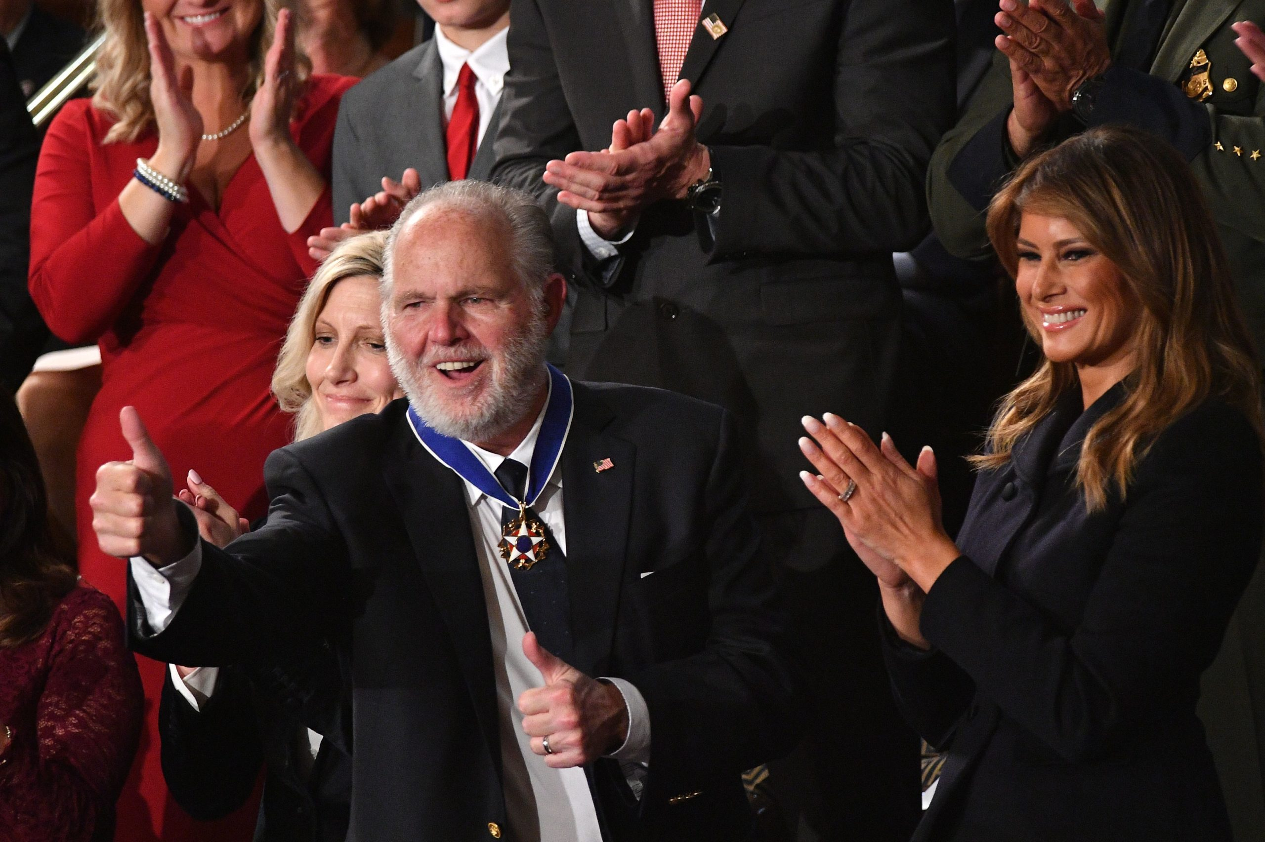 Radio personality Rush Limbaugh pumps thumb after being awarded the Medal of Freedom by First Lady Melania Trump after being acknowledged by US President Donald Trump as he delivers the State of the Union address at the US Capitol in Washington, DC, on February 4, 2020. (Photo by MANDEL NGAN / AFP) (Photo by MANDEL NGAN/AFP via Getty Images)