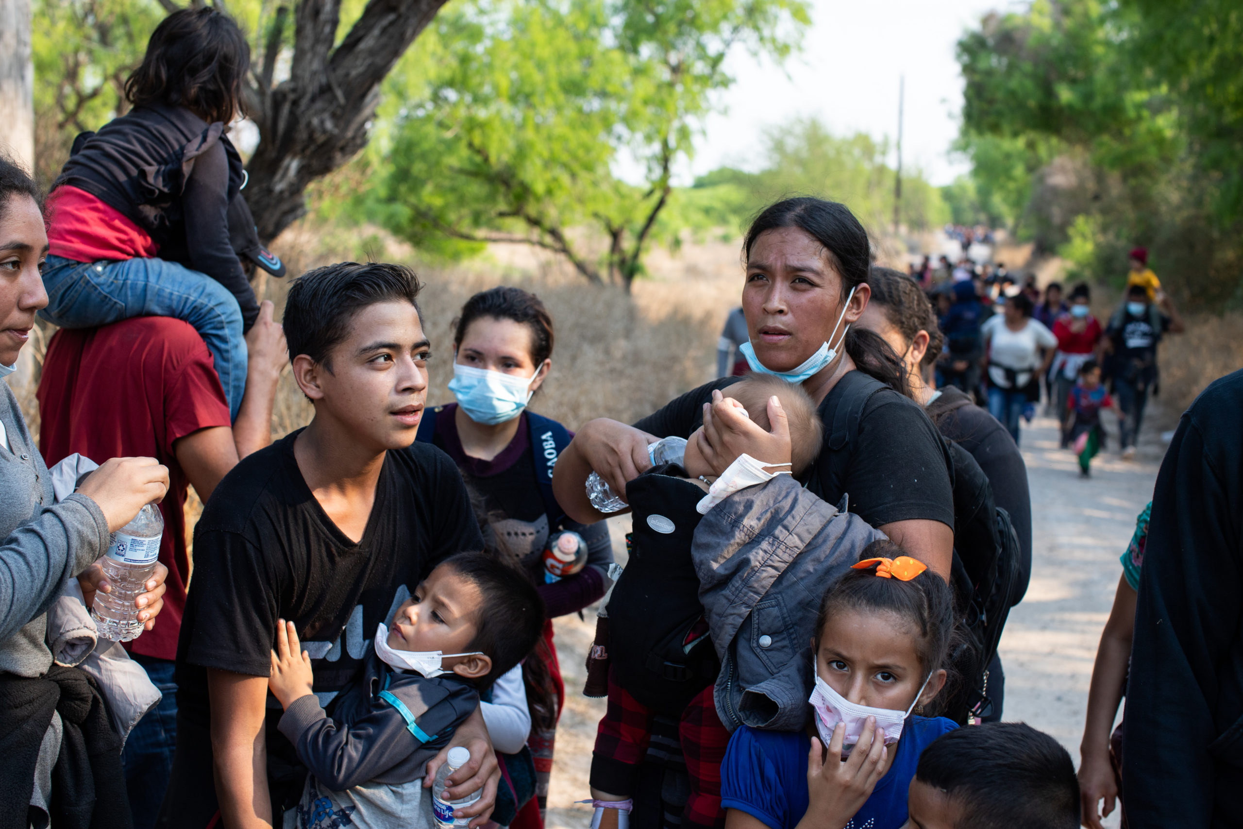 Illegal migrants use a road on private land to access a Customs and Border Protection field processing facility under the Anzalduas International Bridge near Mission, Texas, on March 26, 2021. (Kaylee Greenlee - Daily Caller News Foundation)