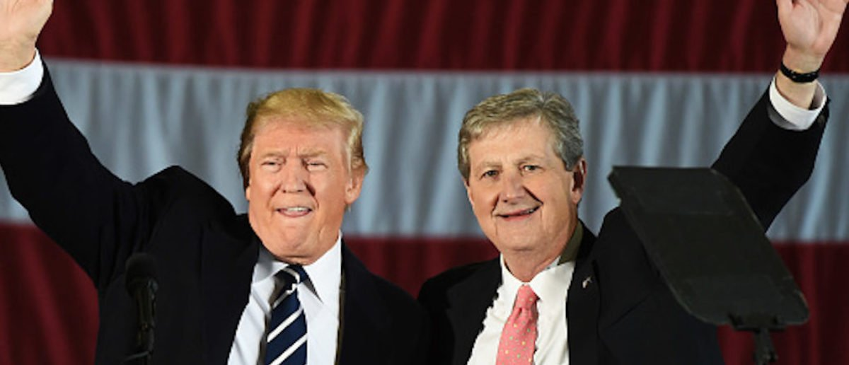US President-elect Donald Trump (L) and Louisiana Treasurer and Republican Senate candidate John Kennedy wave at a get-out-the-vote rally on December 9, 2016 in Baton Rouge, Louisiana. / AFP / DON EMMERT (Photo credit should read DON EMMERT/AFP via Getty Images)
