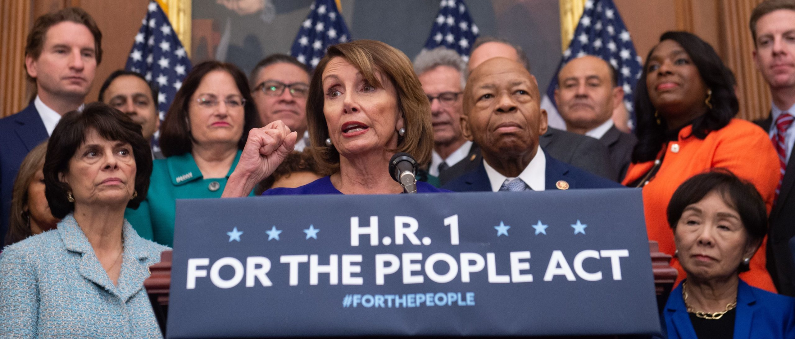 """US Speaker of the House Nancy Pelosi (C), Democrat of California, speaks alongside Democratic members of the House about H.R.1, the """"For the People Act,"""" at the US Capitol in Washington, DC, January 4, 2019. - Democrats announced their first piece of legislation to reform voting rights provisions, ethics reforms and a requirement that presidential candidates release 10 years of tax returns. (Photo by SAUL LOEB / AFP) (Photo credit should read SAUL LOEB/AFP via Getty Images)"""