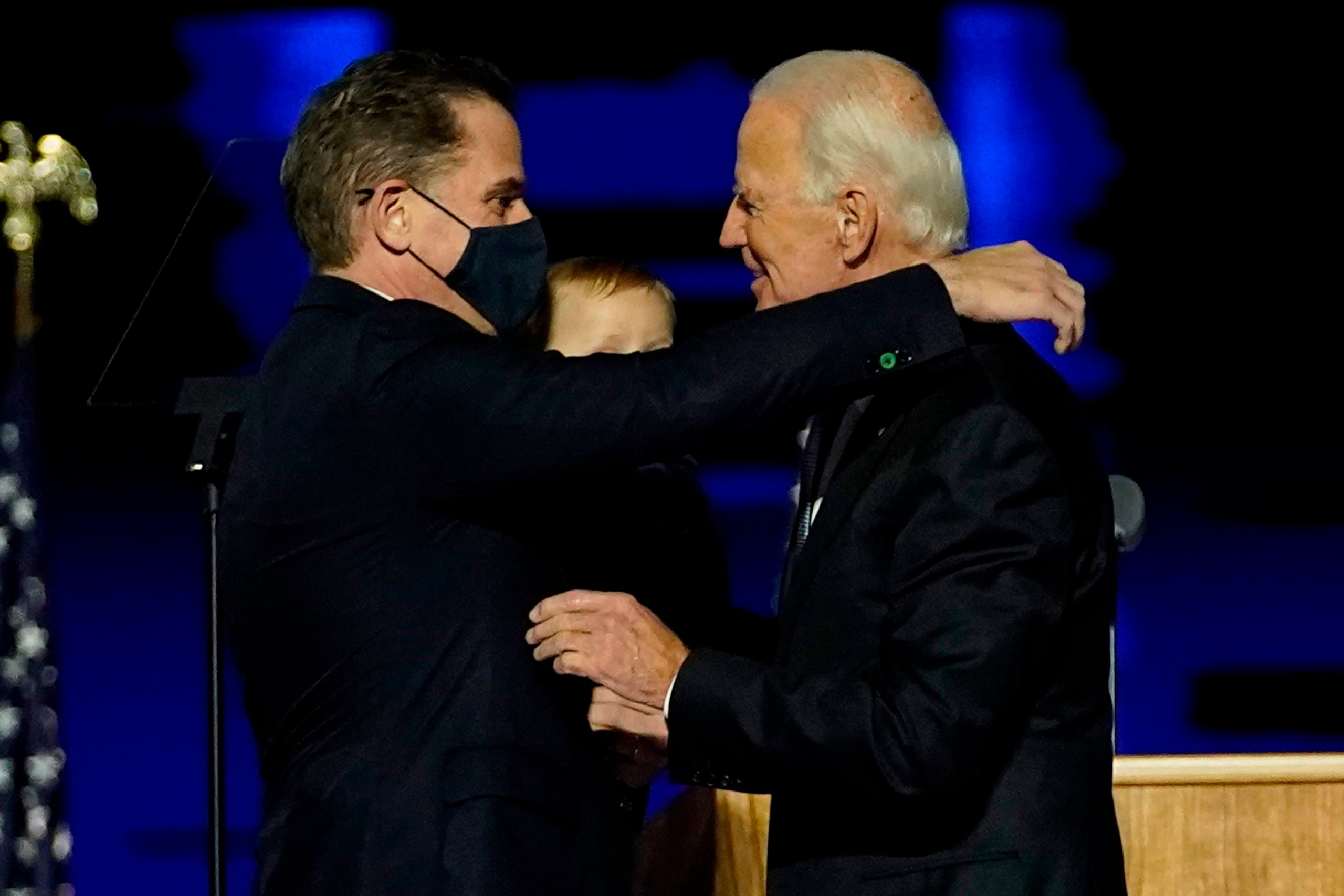WILMINGTON, DELAWARE - NOVEMBER 07: President-elect Joe Biden embraces his son Hunter Biden after addressing the nation from the Chase Center November 07, 2020 in Wilmington, Delaware. After four days of counting the high volume of mail-in ballots in key battleground states due to the coronavirus pandemic, the race was called for Biden after a contentious election battle against incumbent Republican President Donald Trump. (Photo by Andrew Harnik-Pool/Getty Images)