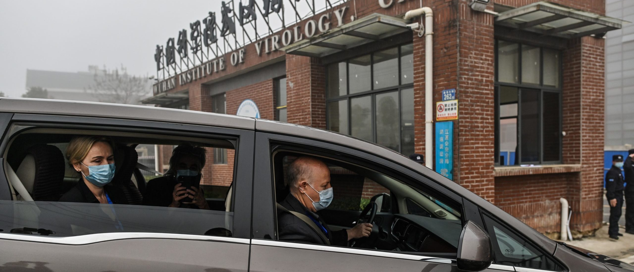 Peter Daszak (R), Thea Fischer (L) and other members of the World Health Organization (WHO) team investigating the origins of the COVID-19 coronavirus, arrive at the Wuhan Institute of Virology in Wuhan in China's central Hubei province on February 3, 2021. (Photo by Hector RETAMAL / AFP) (Photo by HECTOR RETAMAL/AFP via Getty Images)