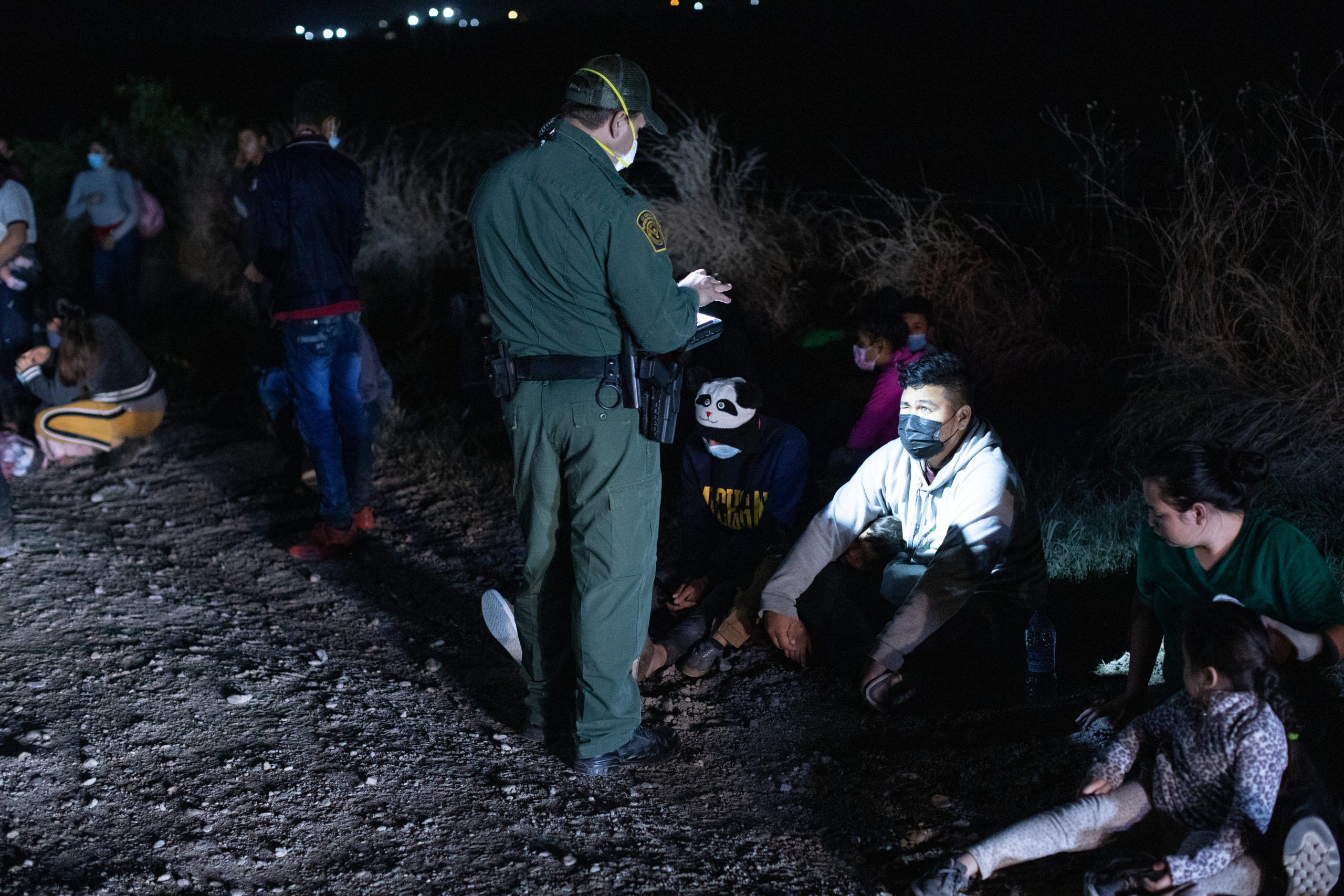 Customs and Border Protection officials work on processing groups of migrants arriving illegally in the U.S. in the middle of the night on March 26, near La Joya, Texas. (Kaylee Greenlee - Daily Caller News Foundation)