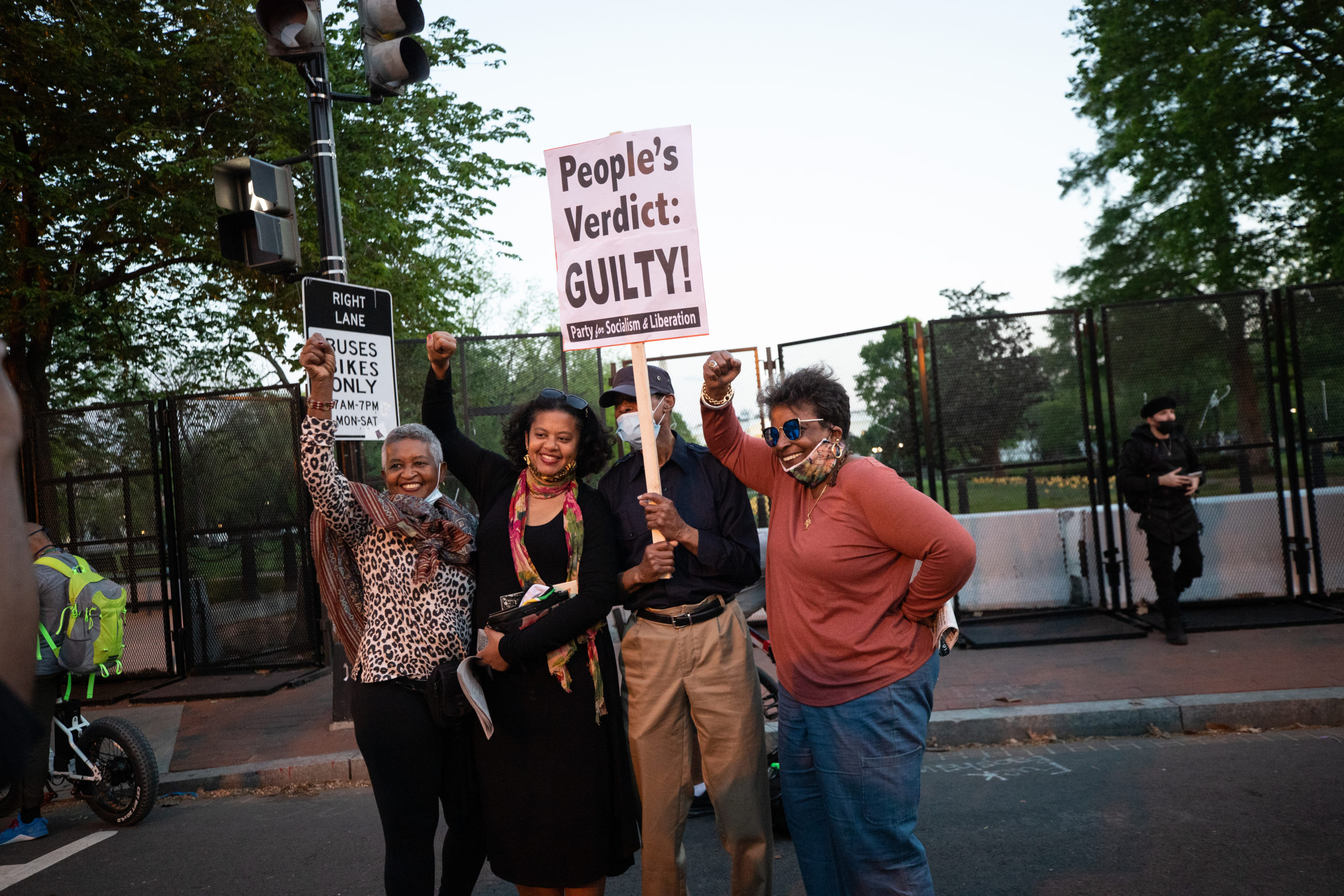 People raised their fists and posed for photographs at Black Lives Matter Plaza after the jury's decision in the Derek Chauvin trial was announced on April 20, 2021, in Washington, D.C. (Kaylee Greenlee - Daily Caller News Foundation)