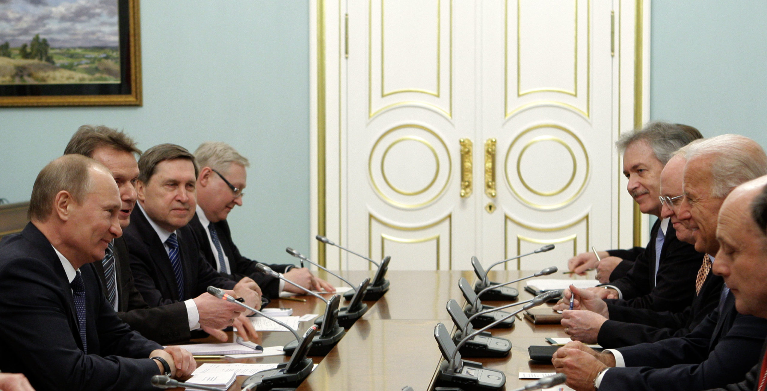 """Russian Prime Minister Vladimir Putin (L) and US Vice President Joe Biden (2nd R) meet on March 10, 2011 with their delegations in Moscow. Putin on March 10 proposed to Biden that Russia and the United States abolish visas in a """"historic"""" step to seal a revival in ties. Biden's visit is aimed at building on the """"reset"""" in relations spearheaded by Russian President Dmitry Medvedev but Putin has until now enjoyed less cordial relations with Washington than his successor as Kremlin chief. (Photo credit should read ALEXEY DRUZHININ/AFP via Getty Images)"""