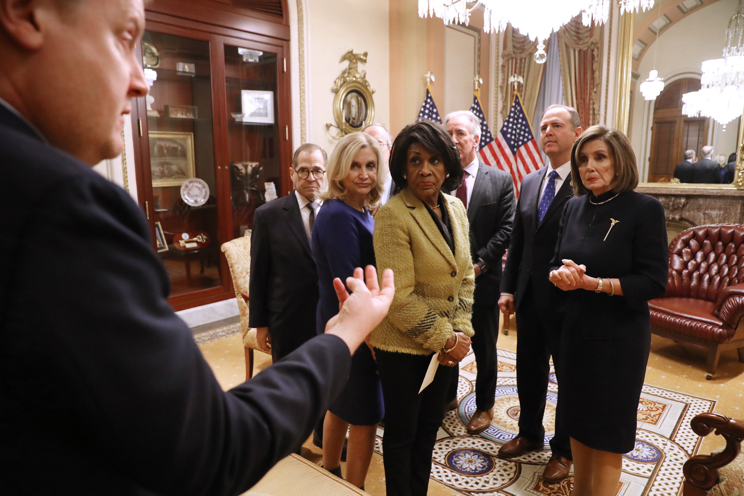 Rep. Maxine Waters (center-left), Speaker Nancy Pelosi and other Democratic committee chairs on December 18, 2019. (Chip Somodevilla/Getty Images)