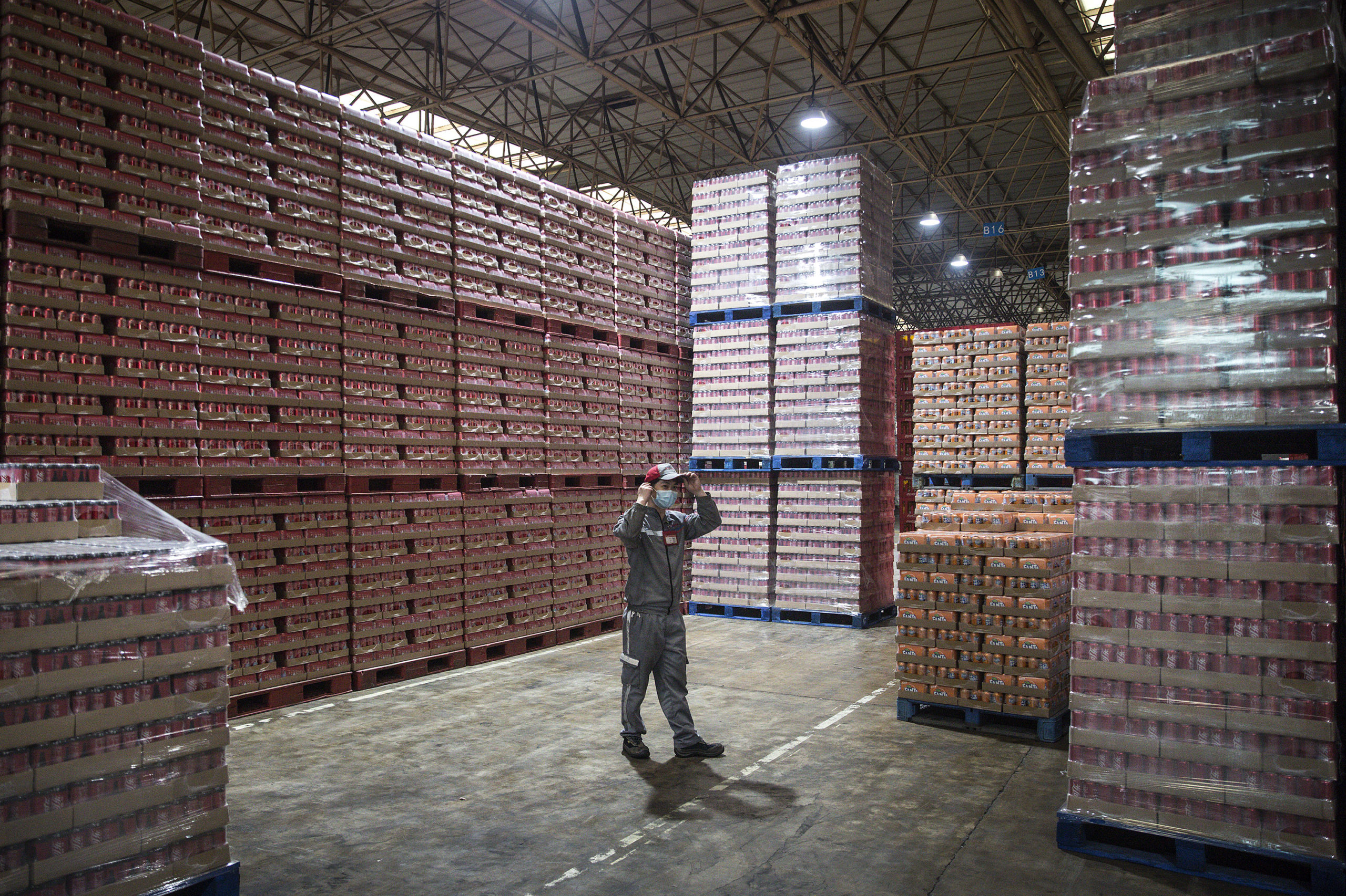An employee works in the warehouse of the Coca-Cola Beverages factory in 2020 in Wuhan, Hubei province, China. (Getty Images)