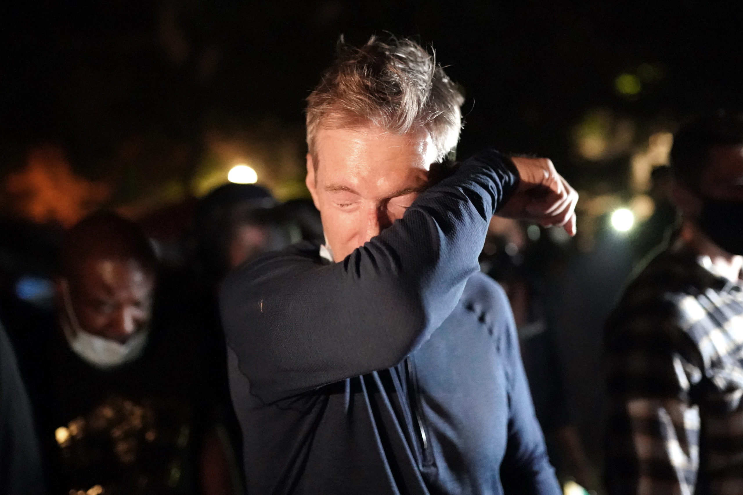 Portland Mayor Ted Wheeler reacts after being exposed to tear gas fired by federal officers while attending a protest against police brutality and racial injustice in front of the Mark O. Hatfield U.S. Courthouse on July 22, 2020 in Portland, Oregon. State and city elected officials have called for the federal officers to leave Portland as clashes between protesters and federal police continue to escalate. (Photo by Nathan Howard/Getty Images)
