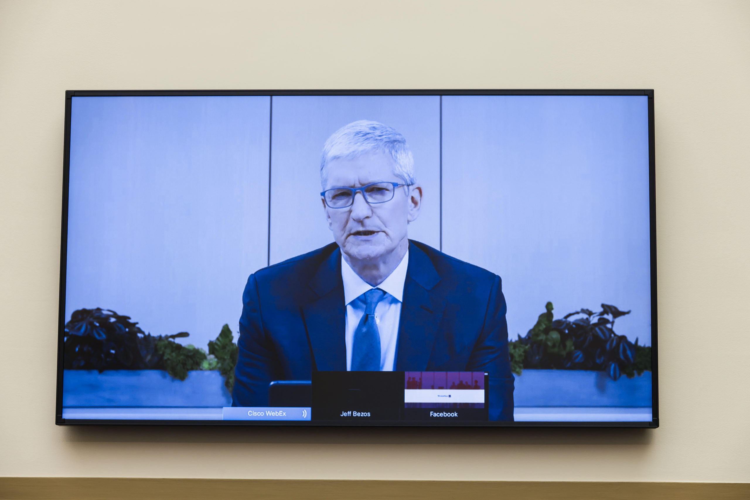 """Apple CEO Tim Cook speaks via video conference during an Antitrust, Commercial and Administrative Law Subcommittee hearing, on Capitol Hill, in Washington, Wednesday, July 29, 2020, on """"Online Platforms and Market Power"""" in the Rayburn House office Building on Capitol Hill in Washington, DC on July 29, 2020. (Photo by GRAEME JENNINGS/POOL/AFP via Getty Images)"""
