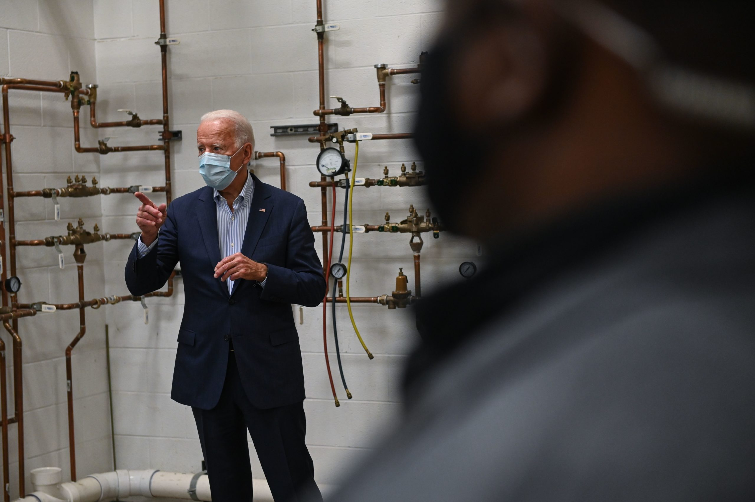 President Joe Biden tours a local plumbers union training center in Erie, Pennsylvania on Oct. 10. (Roberto Schmidt/AFP via Getty Images)