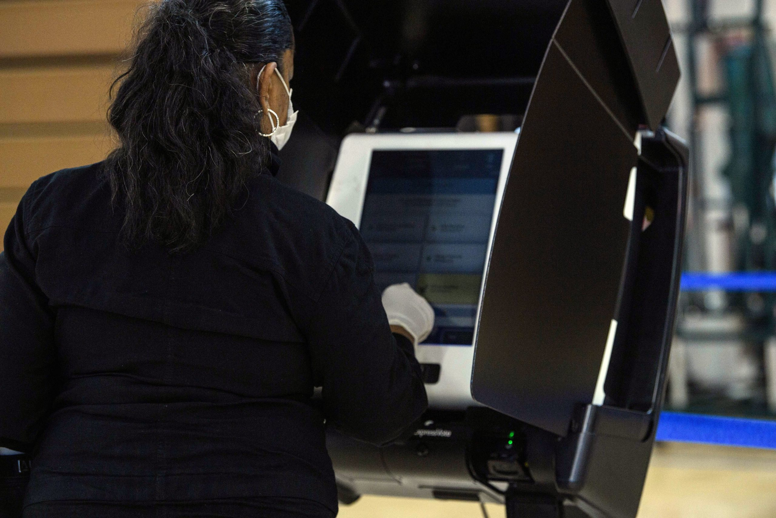 A woman uses an electronic voting machine at a polling station in Washington, DC, on October 29, 2020 during early voting. (Photo by NICHOLAS KAMM / AFP) (Photo by NICHOLAS KAMM/AFP via Getty Images)