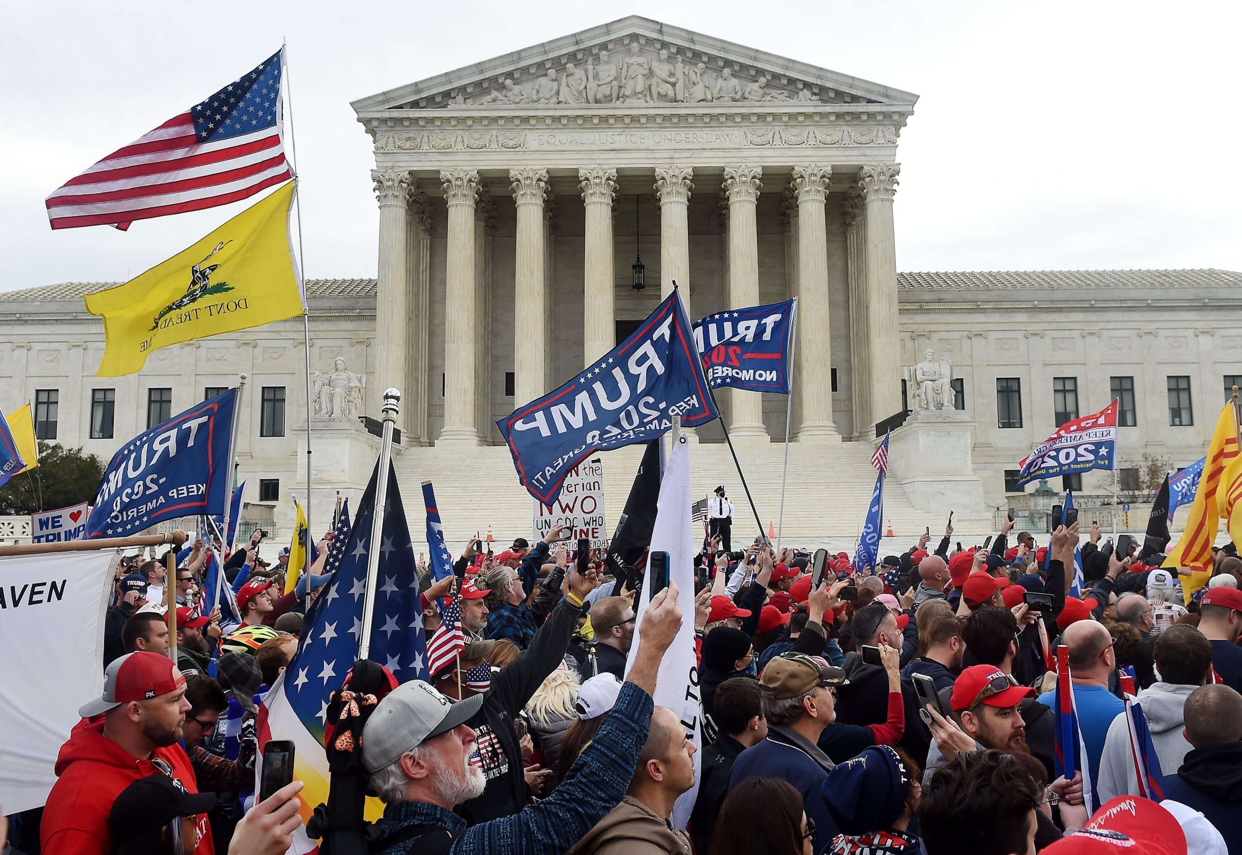 Supporters of US President Donald Trump participate in the Million MAGA March to protest the outcome of the 2020 presidential election, in front of the US Supreme Court on December 12, 2020 in Washington, DC. (Photo by Olivier DOULIERY / AFP) (Photo by OLIVIER DOULIERY/AFP via Getty Images)