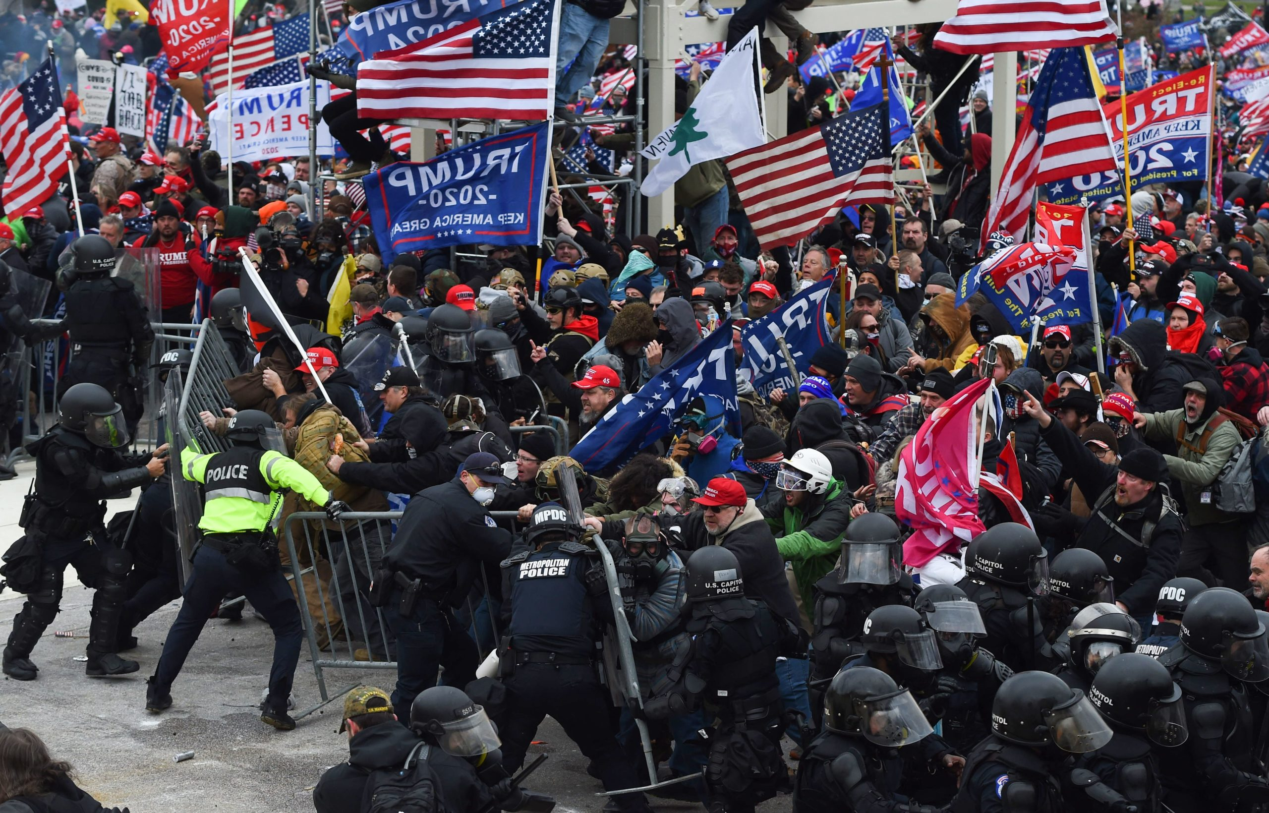 Trump supporters clash with police and security forces as they push barricades to storm the Capitol in Washington D.C on Jan. 6. (Roberto Schmidt/AFP via Getty Images)