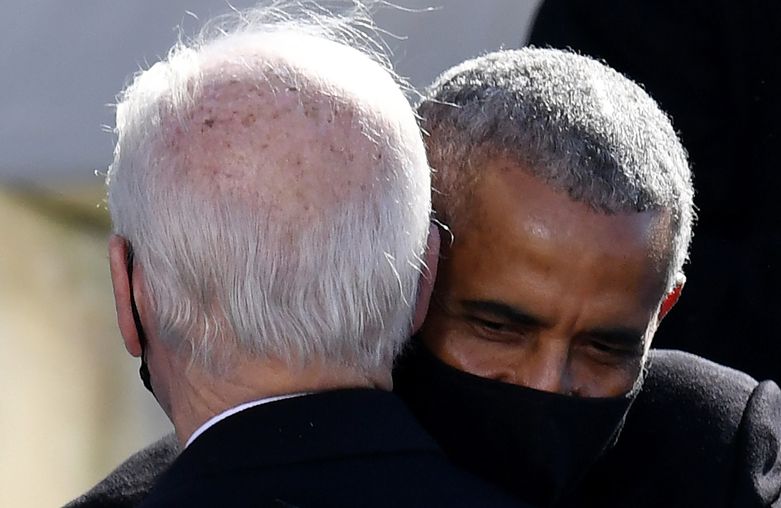 Former US President Barack Obama hugs US president Joe Biden during his inauguration as the 46th US President on January 20, 2021, at the US Capitol in Washington, DC. (Photo by OLIVIER DOULIERY/AFP via Getty Images)