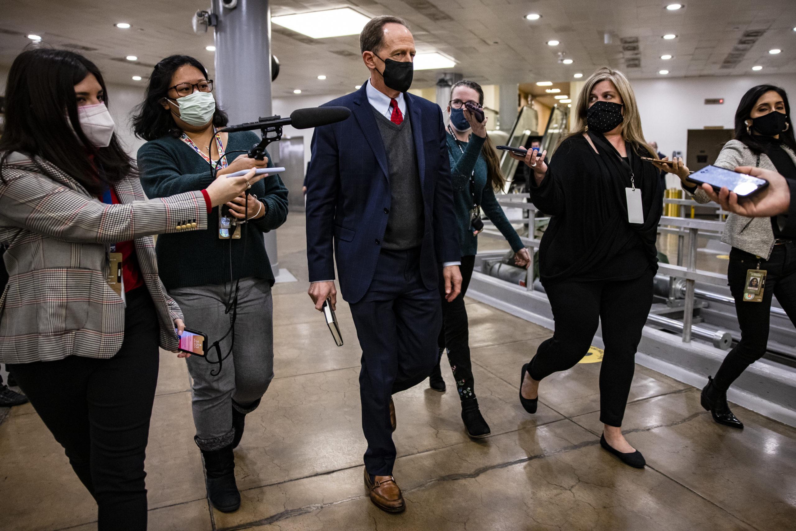 Sen. Pat Toomey walks through the Senate subway in February. (Samuel Corum/Getty Images)