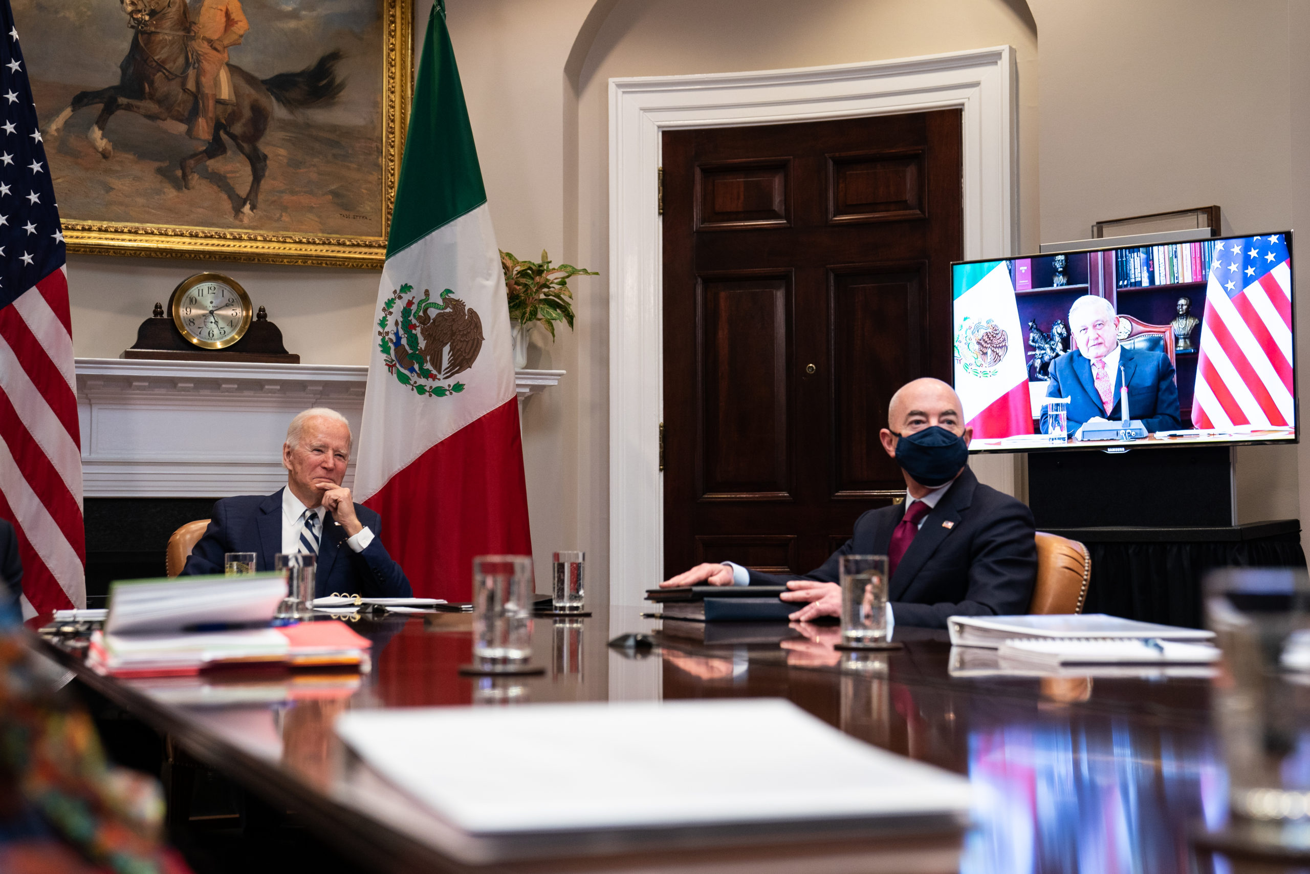 WASHINGTON, DC - MARCH 01: U.S. President Joe Biden (L) and Secretary of Homeland Security Alejandro Mayorkas (C) attend a virtual meeting with Mexican President Andrés Manuel López Obrador (on monitor) in the Roosevelt Room of the White House on March 1, 2021 in Washington, DC. (Photo by Anna Moneymaker-Pool/Getty Images)