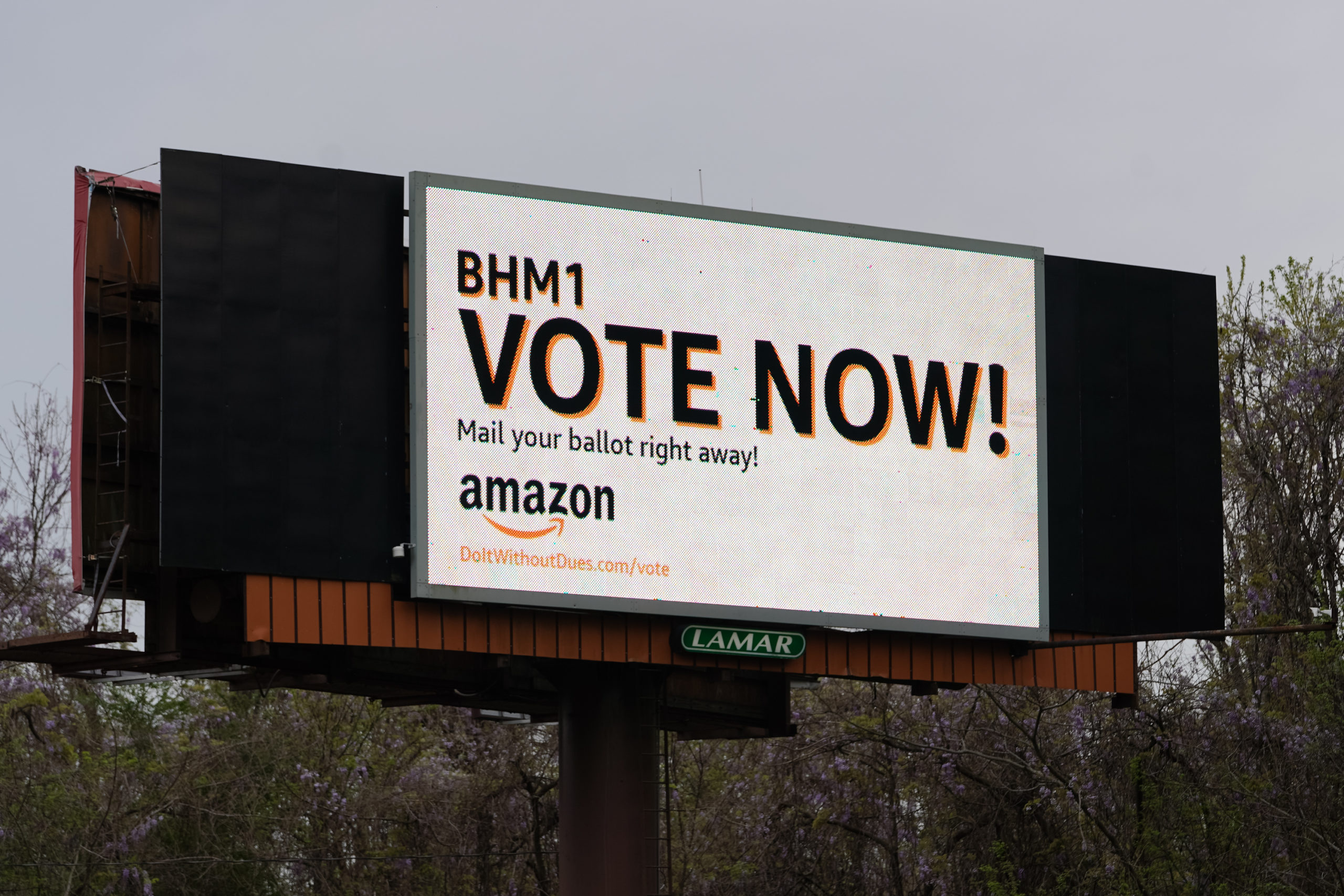 An Amazon-sponsored billboard urging employees to return their unionization ballots is seen on March 28 in Bessemer, Alabama. (Elijah Nouvelage/Getty Images)