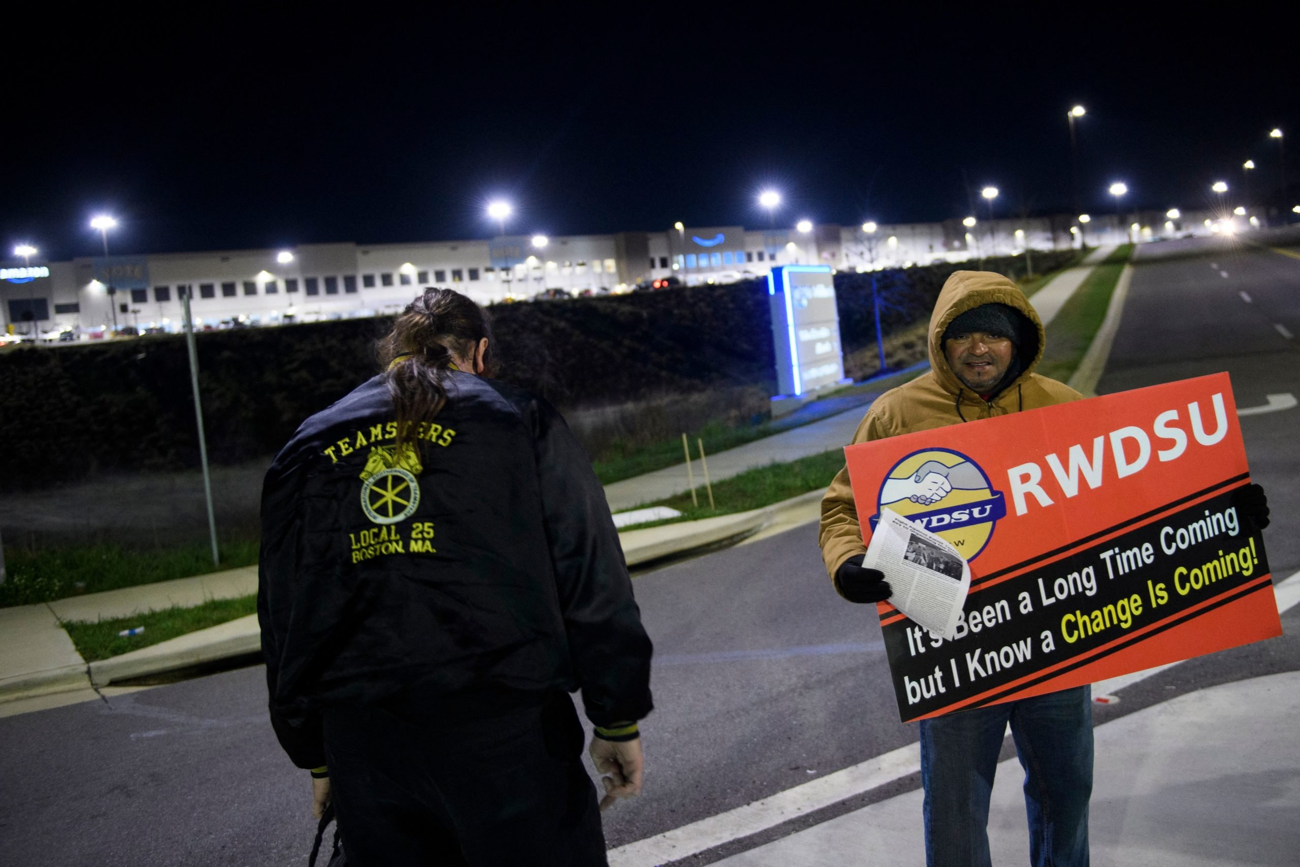 Union supporters distribute information outside of Amazon's fulfillment center in Bessemer, Alabama on March 29. (Patrick T. Fallon/AFP via Getty Images)