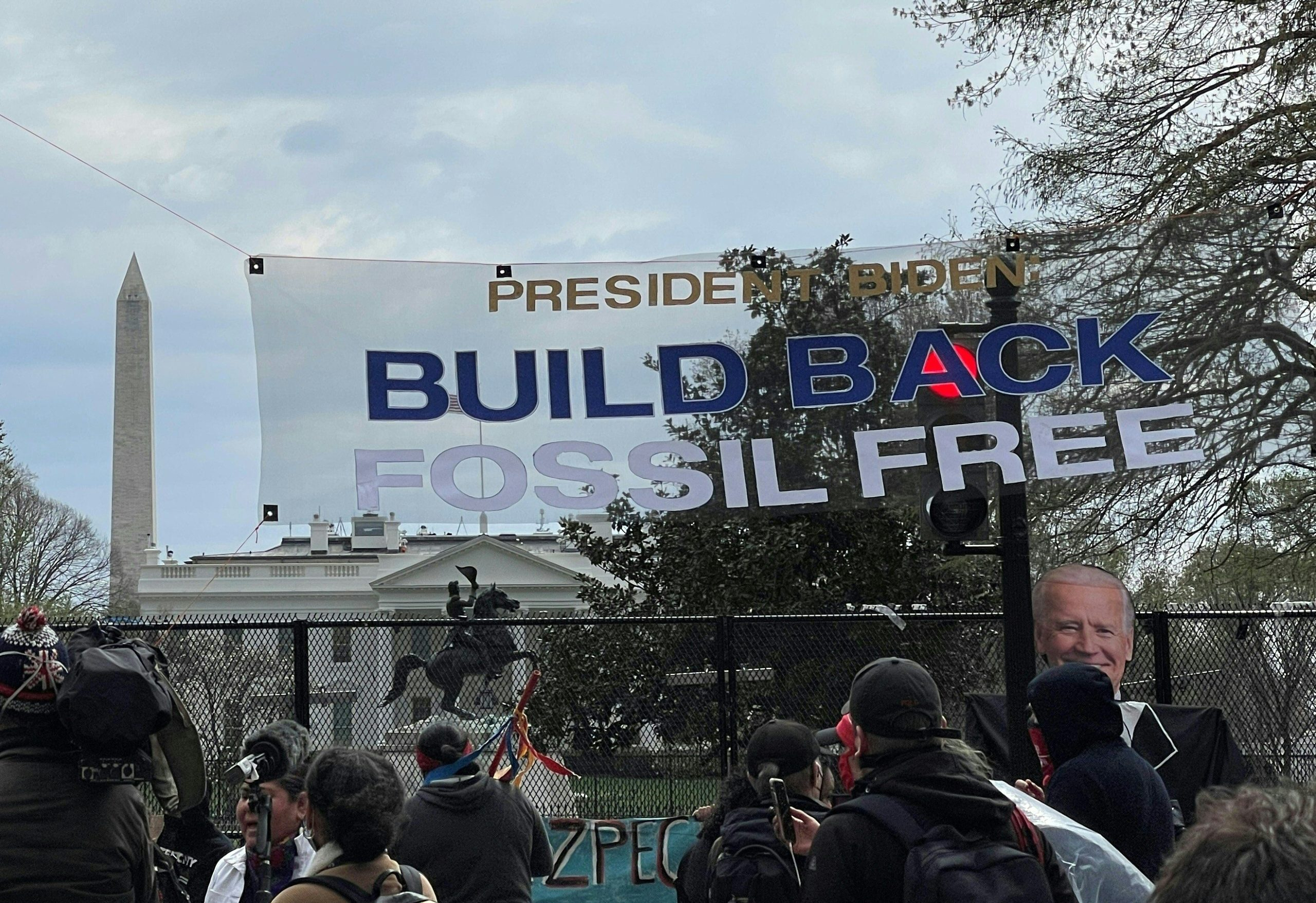 Activists display banners in support of shutting down existing oil pipelines in the U.S. on April 1 in Washington D.C. (Daniel Slim/AFP via Getty Images)