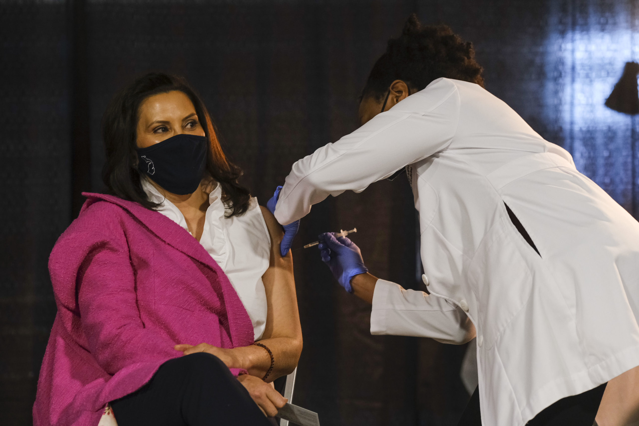 Michigan Governor Gretchen Whitmer receives a dose of the Pfizer Covid vaccine at Ford Field during an event to promote and encourage Michigan residents to get the vaccine on April 6, 2021 in Detroit, Michigan. As the US reaches a milestone in vaccinations, a surge of new Covid-19 cases has swept through the US with Michigan seeing the highest numbers of new cases. (Photo by Matthew Hatcher/Getty Images)