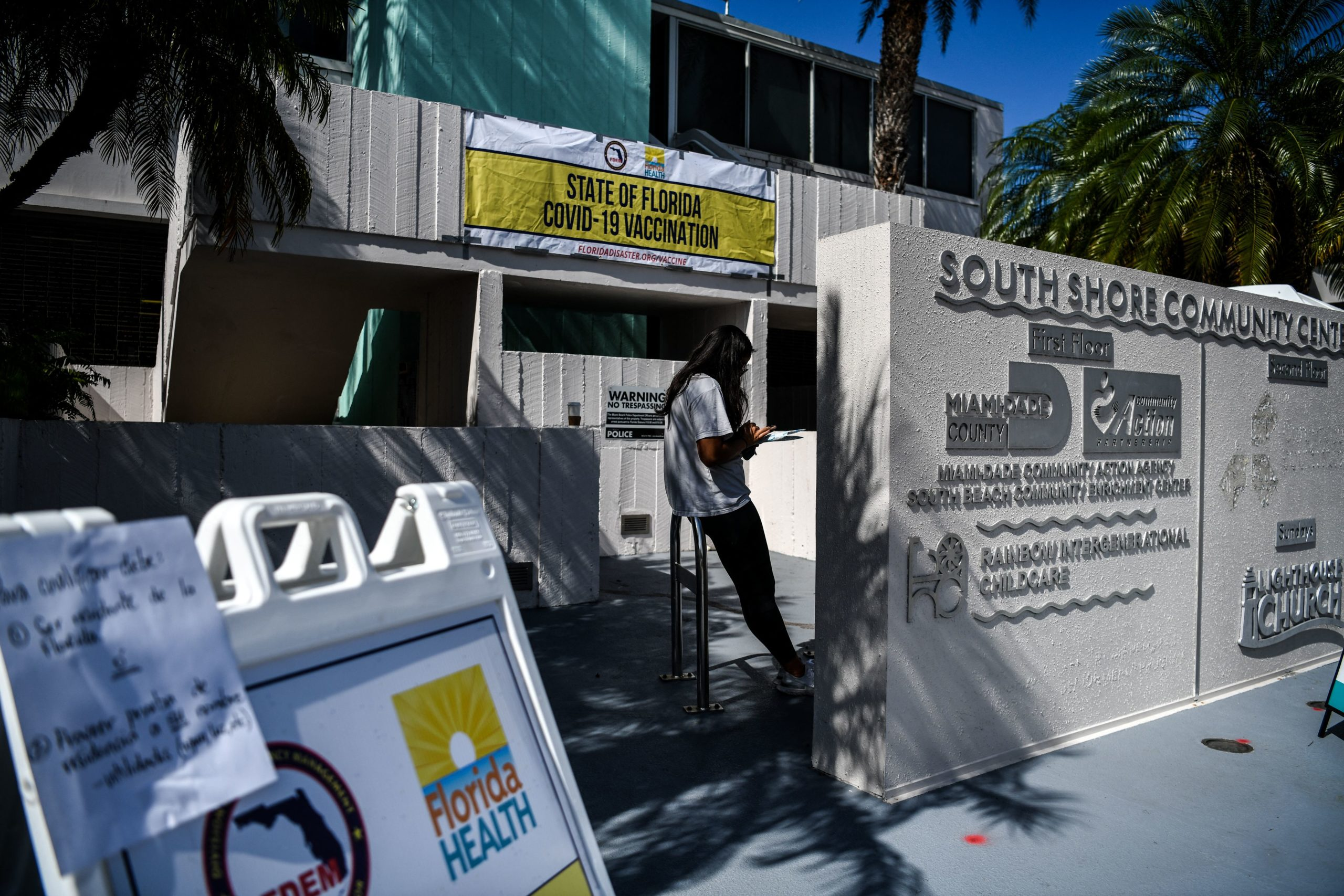 A woman waits for a coronavirus vaccine at a pop-up vaccination site in Miami Beach, Florida on April 8. (Chandan Khanna/AFP via Getty Images)