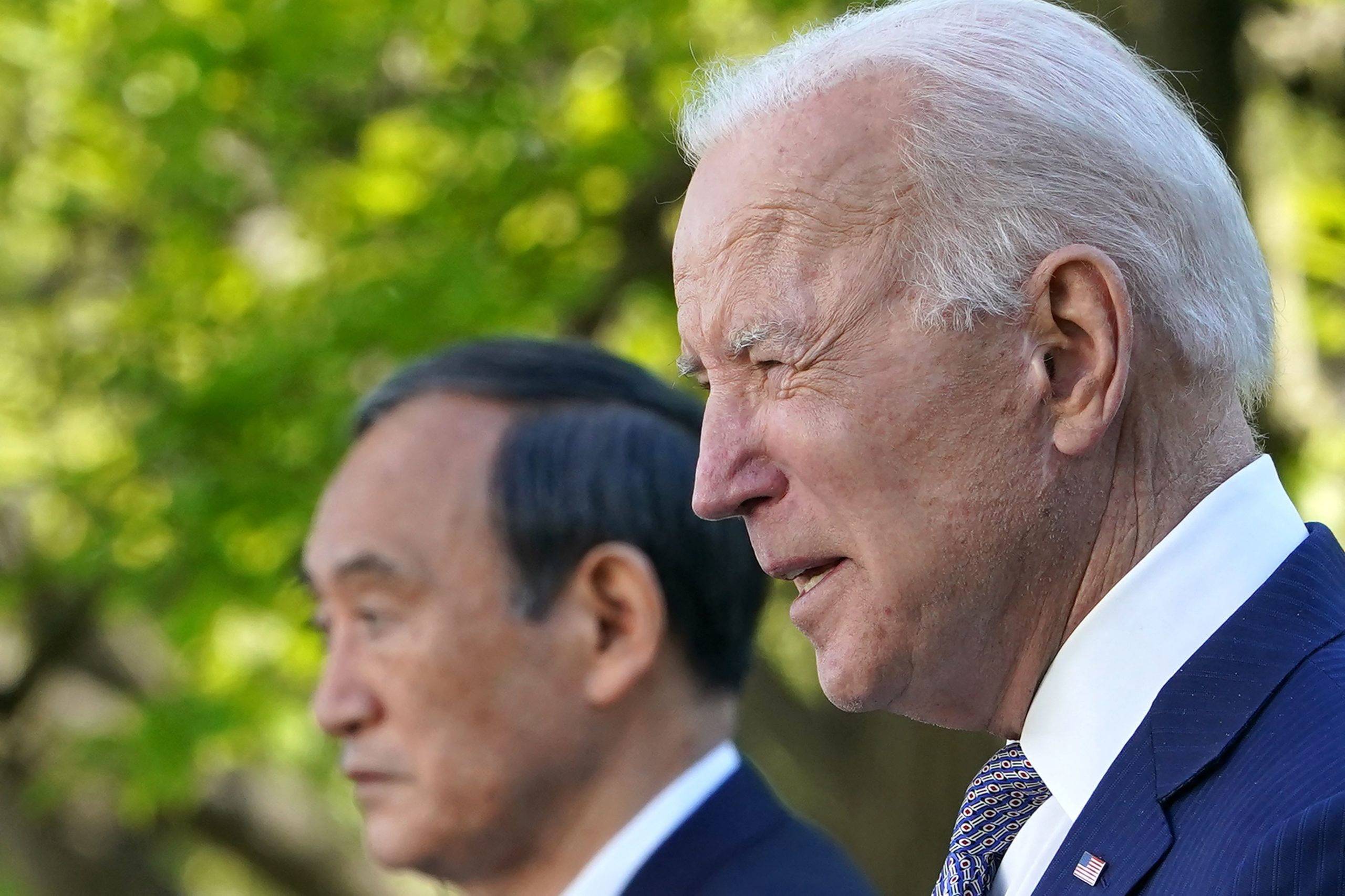 US President Joe Biden and Japan's Prime Minister Yoshihide Suga take part in a joint press conference in the Rose Garden of the White House in Washington, DC on April 16, 2021. (Photo by MANDEL NGAN/AFP via Getty Images)