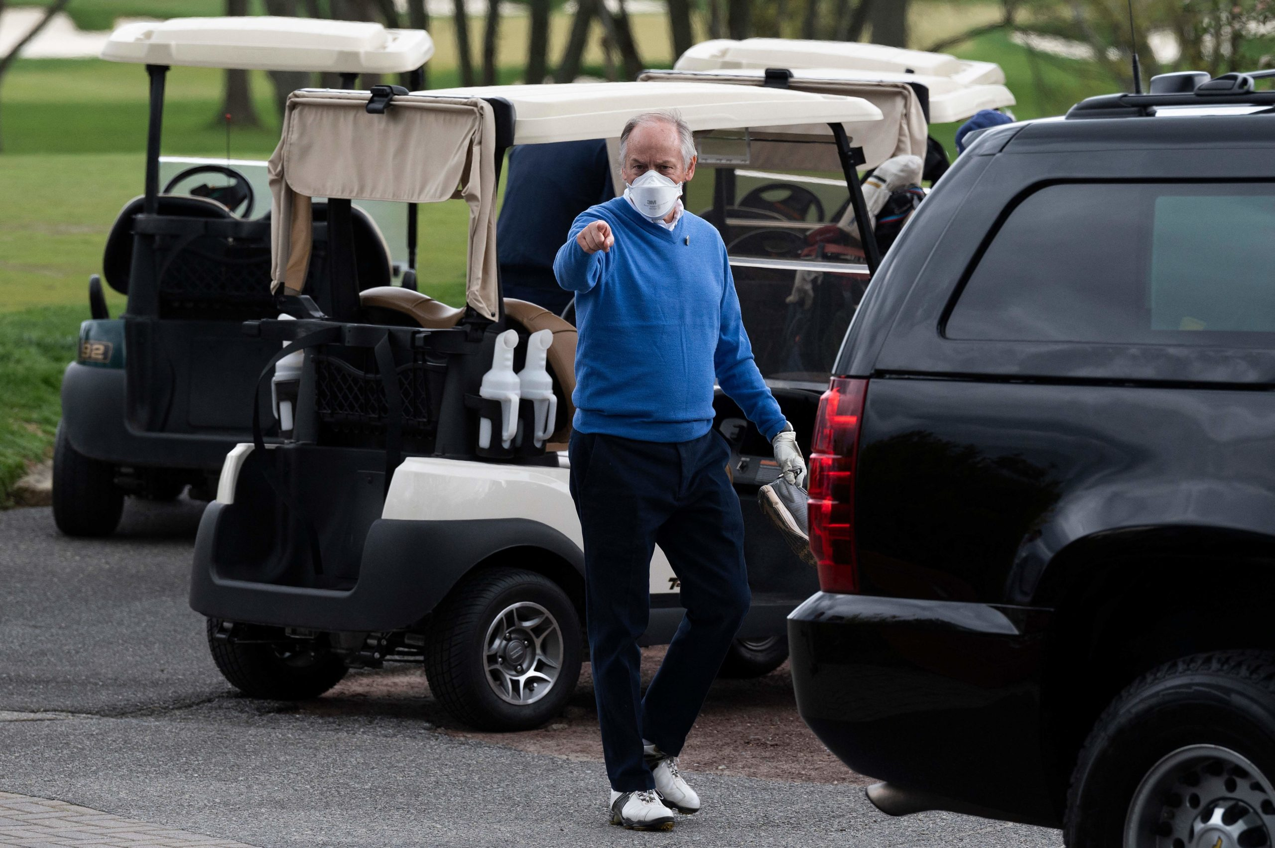 Counselor to the President Steve Ricchetti (C) gestures after playing a round of golf with US President Joe Biden at Wilmington Country Club in Wilmington, Delaware on April 17, 2021. - President Joe Biden played golf for the first time in his presidency Saturday, hitting the fairways in his home city of Wilmington. (Photo by Jim Watson/AFP via Getty Images)