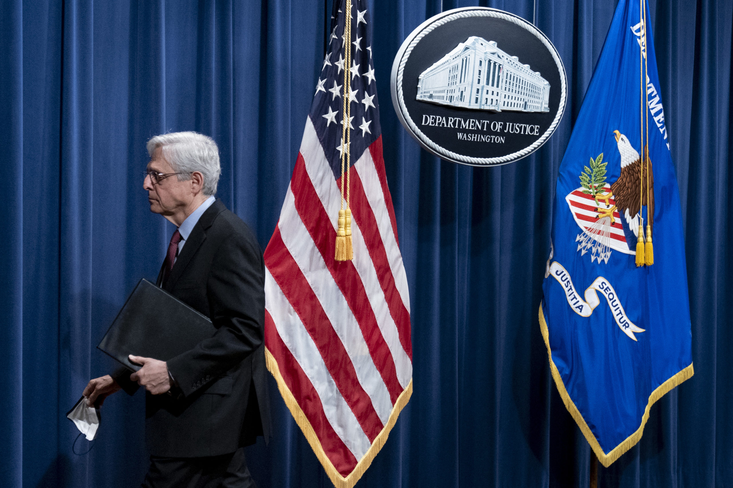 Attorney General Merrick Garland leaves after speaking at the Department of Justice on Wednesday. (Andrew Harnik/Pool/AFP via Getty Images)