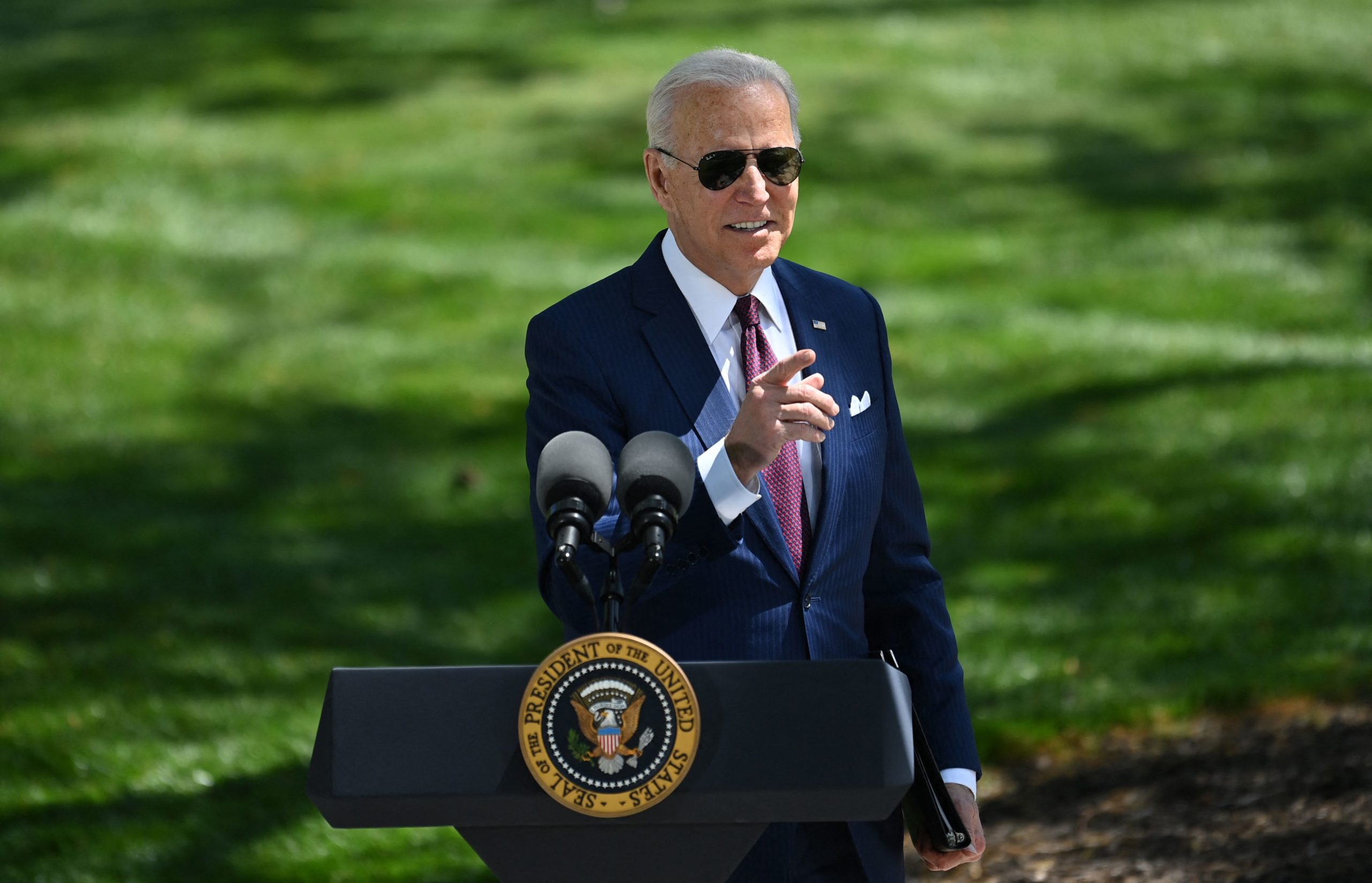 US President Joe Biden gestures as he delivers remarks on the Covid-19 response outside the White House in Washington, DC on April 27, 2021. (Photo by BRENDAN SMIALOWSKI/AFP via Getty Images)