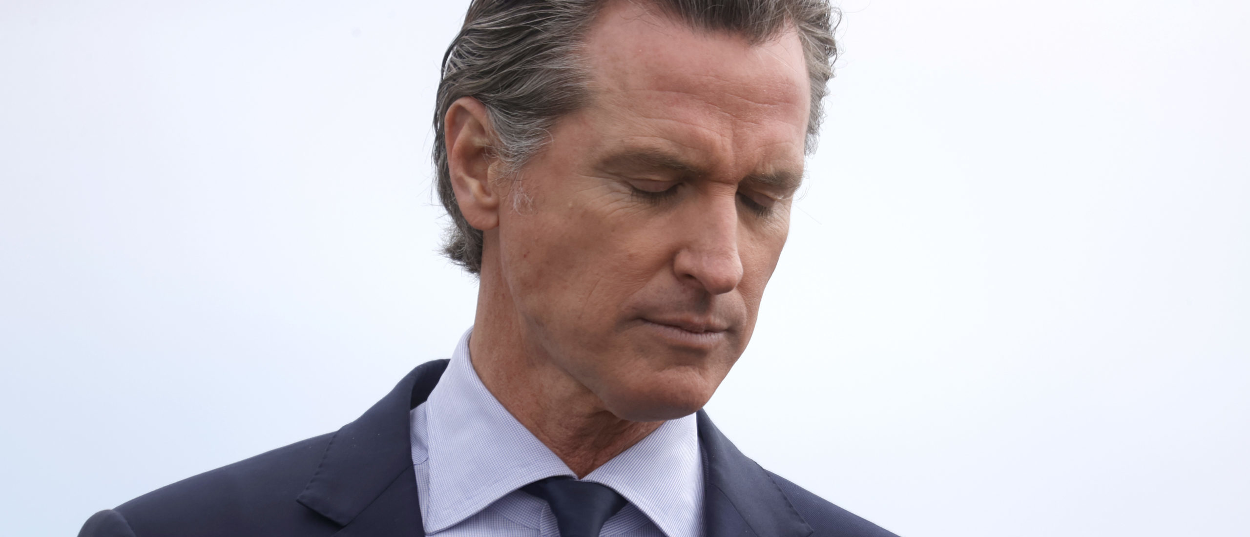 California Gov. Gavin Newsom pauses as he speaks during a news conference after touring the vaccination clinic at City College of San Francisco on April 06, 2021 in San Francisco, California. (Photo by Justin Sullivan/Getty Images)