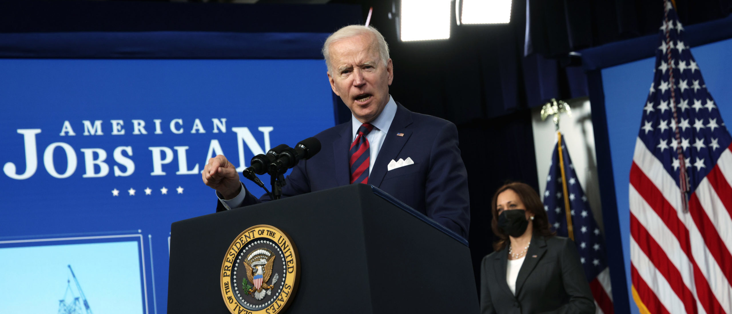 """WASHINGTON, DC - APRIL 07: U.S. President Joe Biden speaks as Vice President Kamala Harris listens during an event at the South Court Auditorium at Eisenhower Executive Office Building April 7, 2021 in Washington DC. President Biden delivered remarks on the administration's """"American Jobs Plan."""" (Photo by Alex Wong/Getty Images)"""