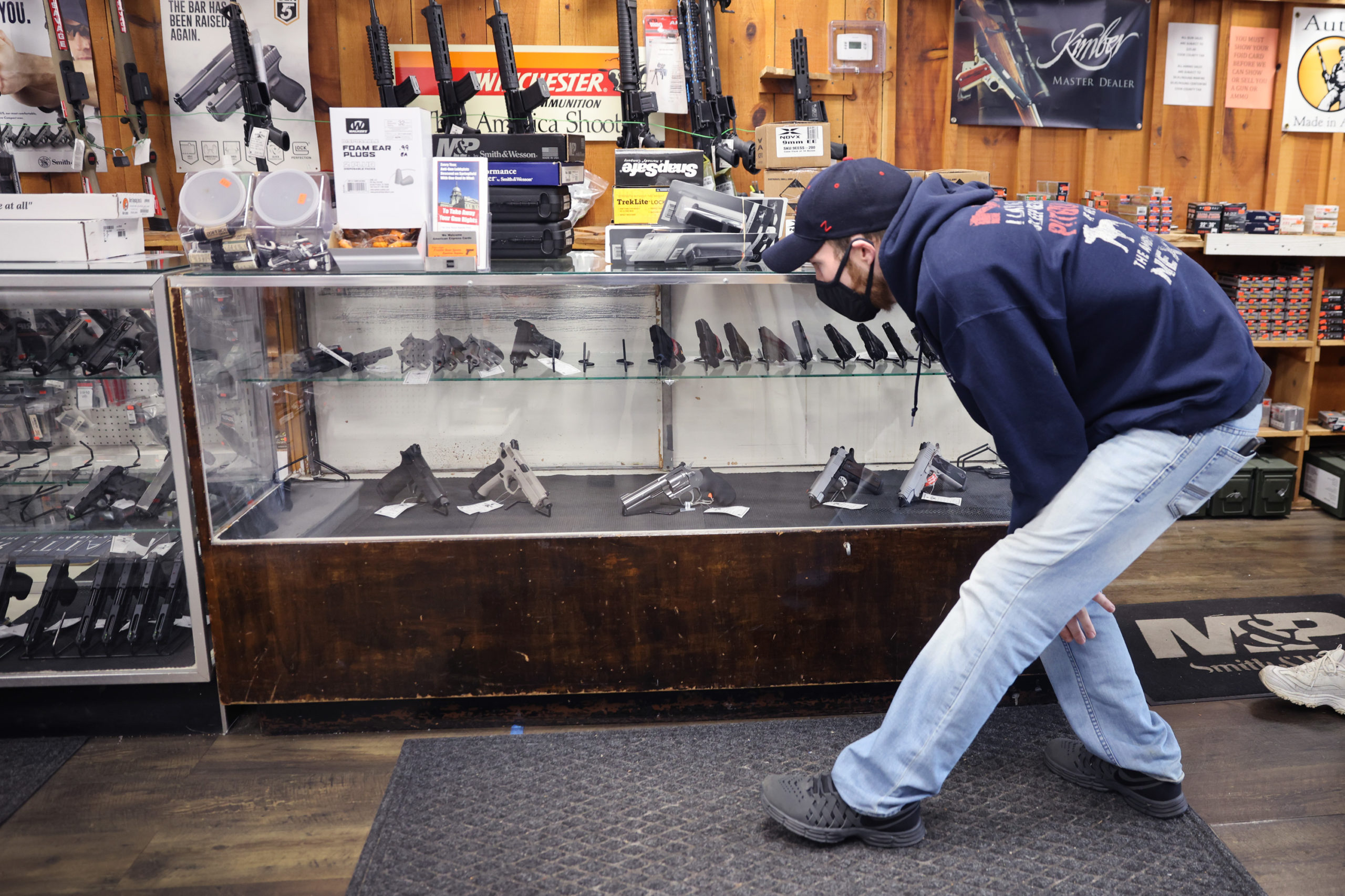 TINLEY PARK, ILLINOIS - APRIL 08: Alexander Carey shops for a new handgun at Freddie Bear Sports on April 08, 2021 in Tinley Park, Illinois. President Joe Biden today announced gun control measures which included stricter controls on the purchase of homemade firearms, commonly referred to as Ghost Guns and he made a push for national Red Flag legislation and other measures. (Photo by Scott Olson/Getty Images)
