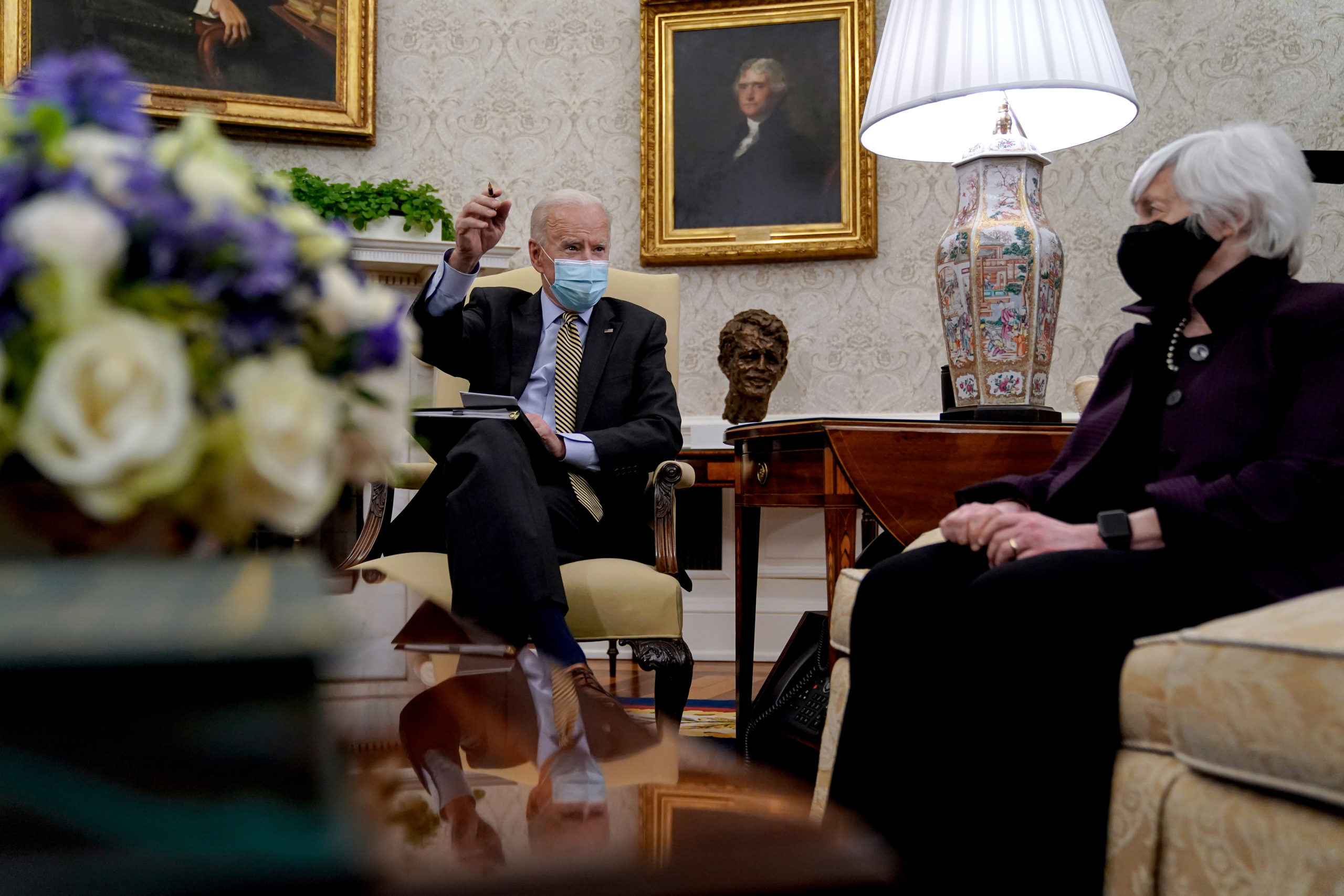 President Joe Biden speaks to Treasury Secretary Janet Yellen listens during the weekly economic briefing in the Oval Office on April 9. (Amr Alfiky/Pool/Getty Images)