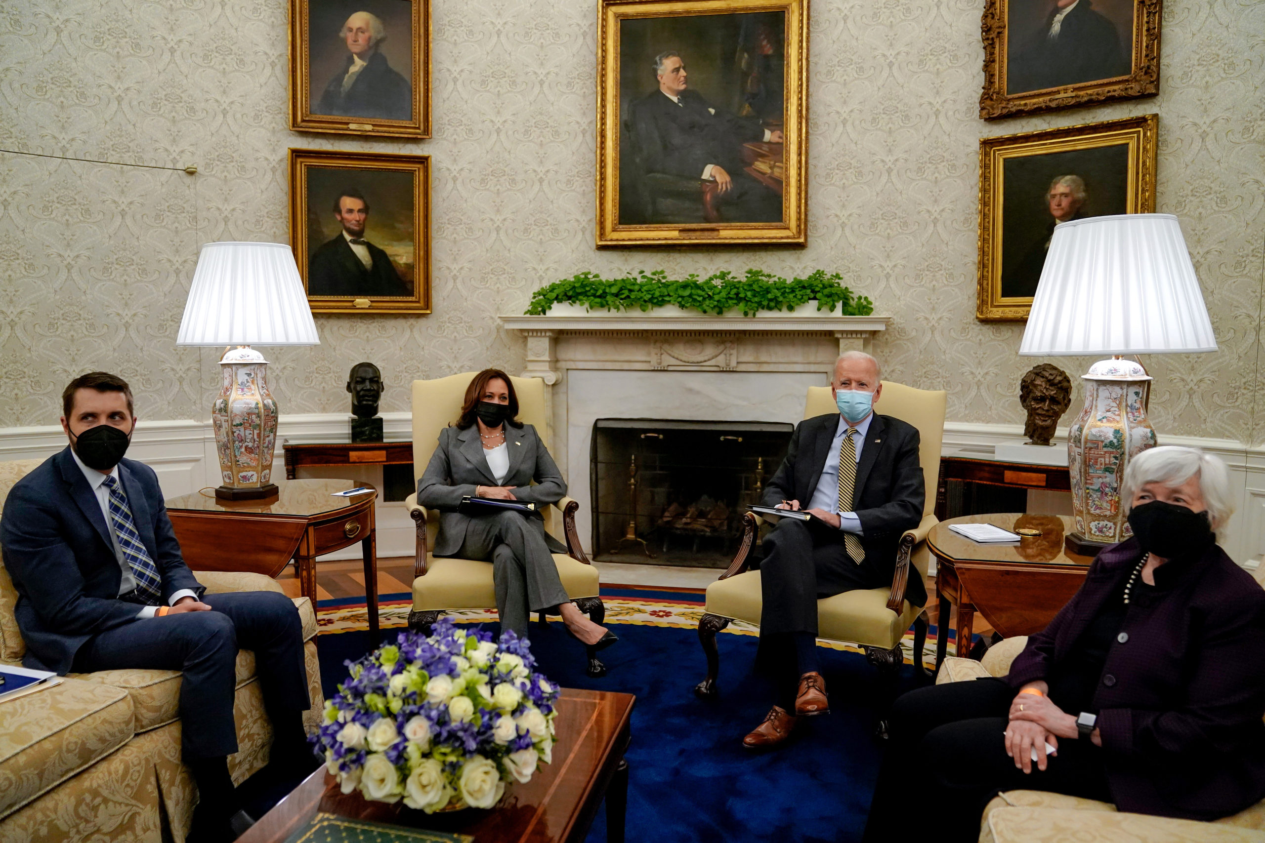 President Joe Biden meets with Vice President Kamala Harris and Secretary of the Treasury Janet Yellen at the White House on Friday. (Amr Alfiky/Pool/Getty Images)
