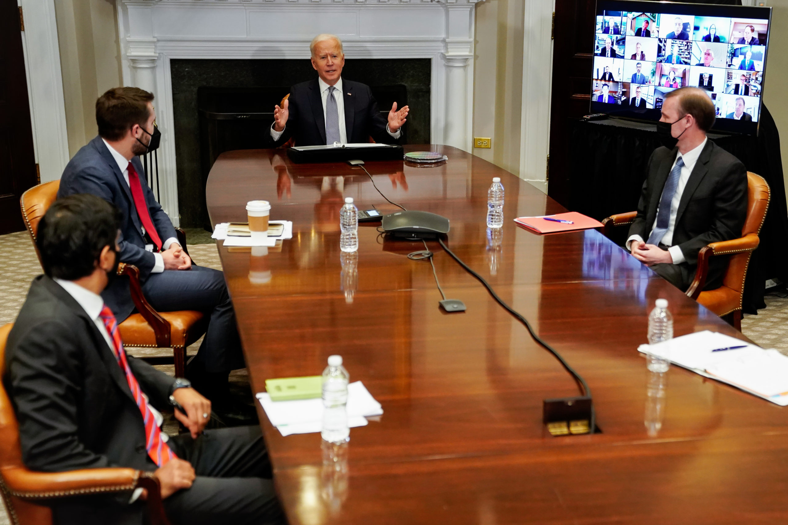 President Joe Biden speaks during a CEO Summit via video conference with National Economic Council Director Brian Deese and others on Monday. (Amr Alfiky/Pool/Getty Images)