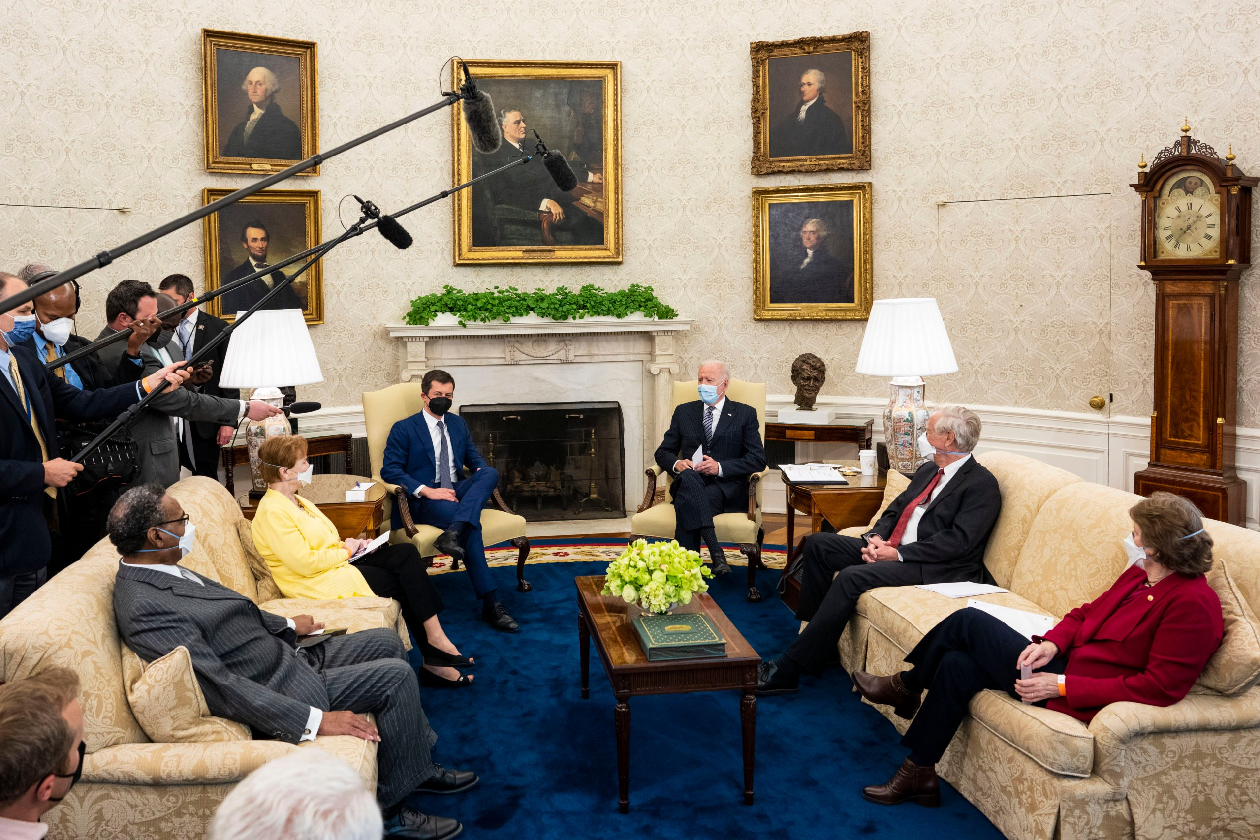 WASHINGTON, DC - APRIL 19: U.S. President Joe Biden (C) speaks during a meeting with a bipartisan group of members of Congress to discuss investments in the American Jobs Plan, including (L-R) Rep. Emanuel Cleaver (D-MO), Rep. Kay Granger (R-TX), Transportation Secretary Pete Buttigieg, Sen. Angus King (I-ME) and Sen. Jeanne Shaheen (D-NH) in the Oval Office at the White House April 19, 2021 in Washington, DC. Biden has proposed raising the corporate tax rate to pay for his initiatives, which include traditional infrastructure projects as well as a major investment in long-term, in-home healthcare. (Photo by Doug Mills-Pool/Getty Images)