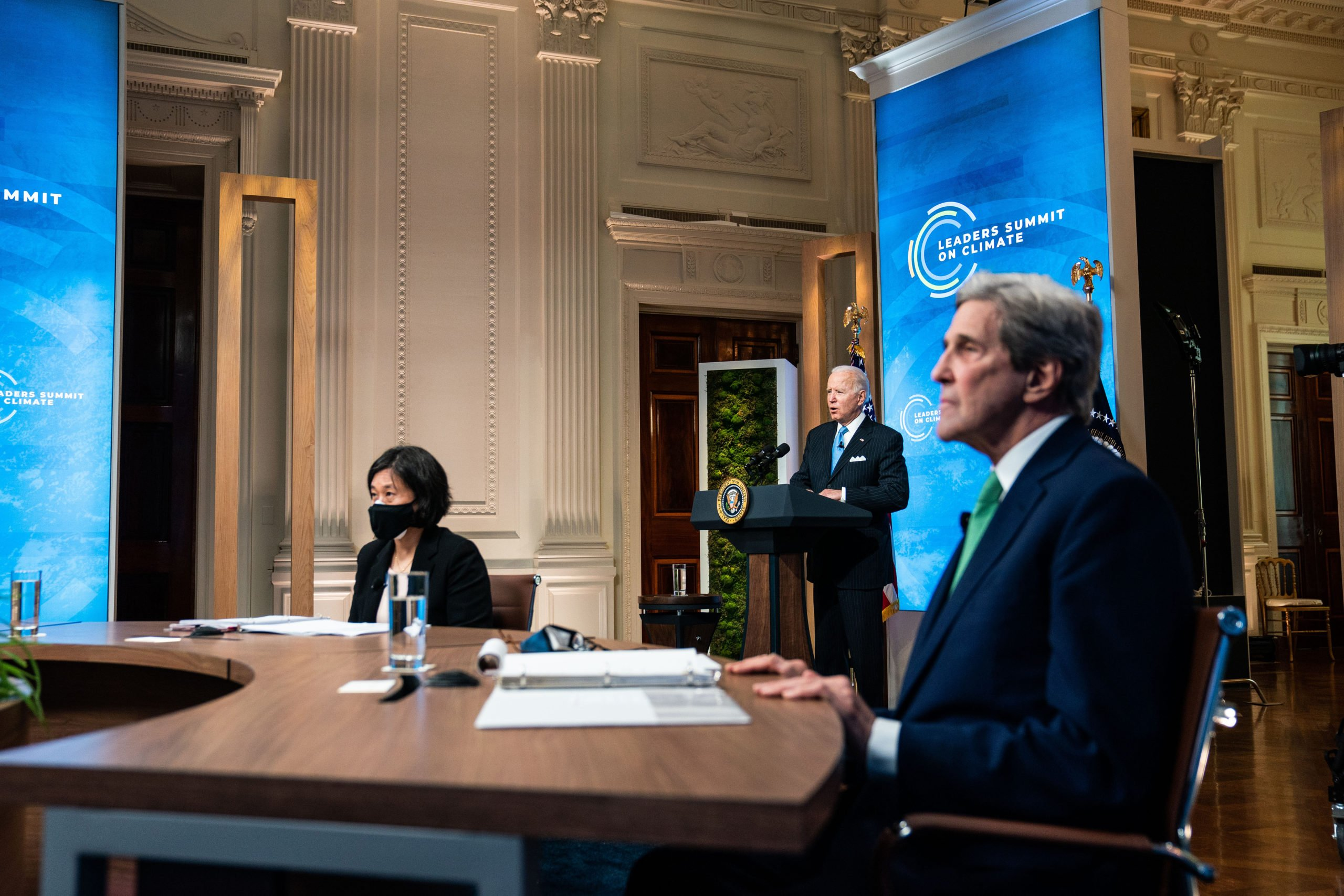 President Joe Biden delivers remarks as U.S. Trade Representative Katherine Tai and Special Presidential Envoy for Climate John Kerry listen at the White House on April 23. (Anna Moneymaker/Pool/Getty Images)