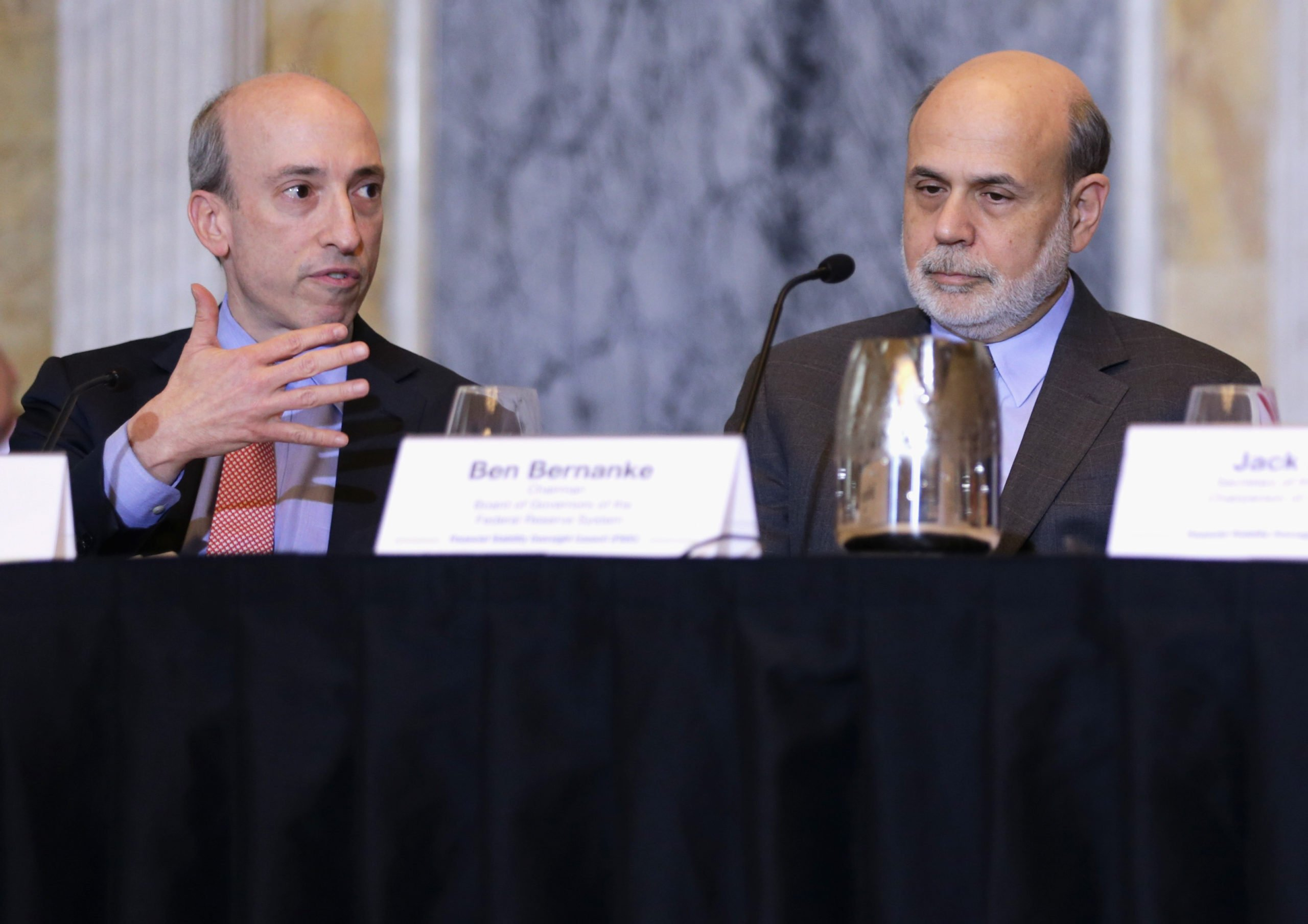 Gary Gensler speaks as former Federal Reserve Board chairman Ben Bernanke listens during a 2013 meeting at the Treasury Department in Washington, D.C. (Alex Wong/Getty Images)
