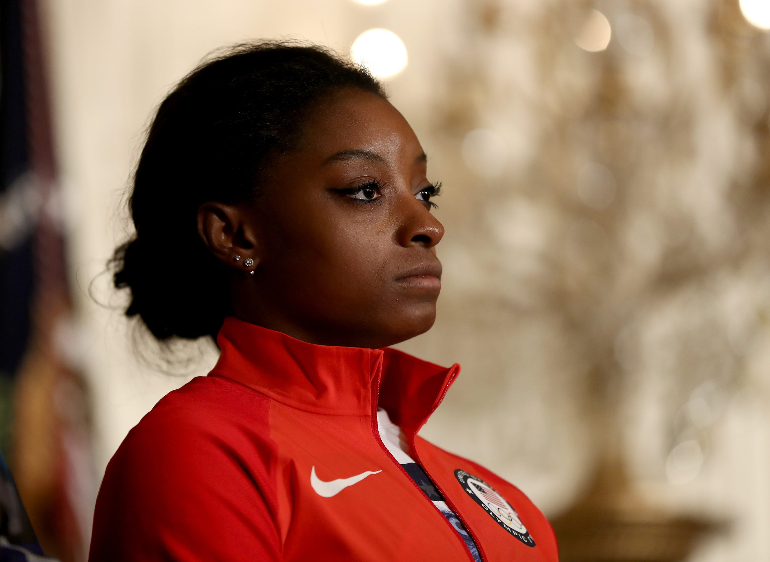 WASHINGTON, DC - SEPTEMBER 29: Olympic medalist Simone Biles stands on stage during an East Room event at the White House September 29, 2016 in Washington, DC. President Obama and first lady Michelle Obama welcome the 2016 U.S. Olympic and Paralympic teams to the White House to honor their participation and success in the Rio Olympic Games this year. (Photo by Elsa/Getty Images)