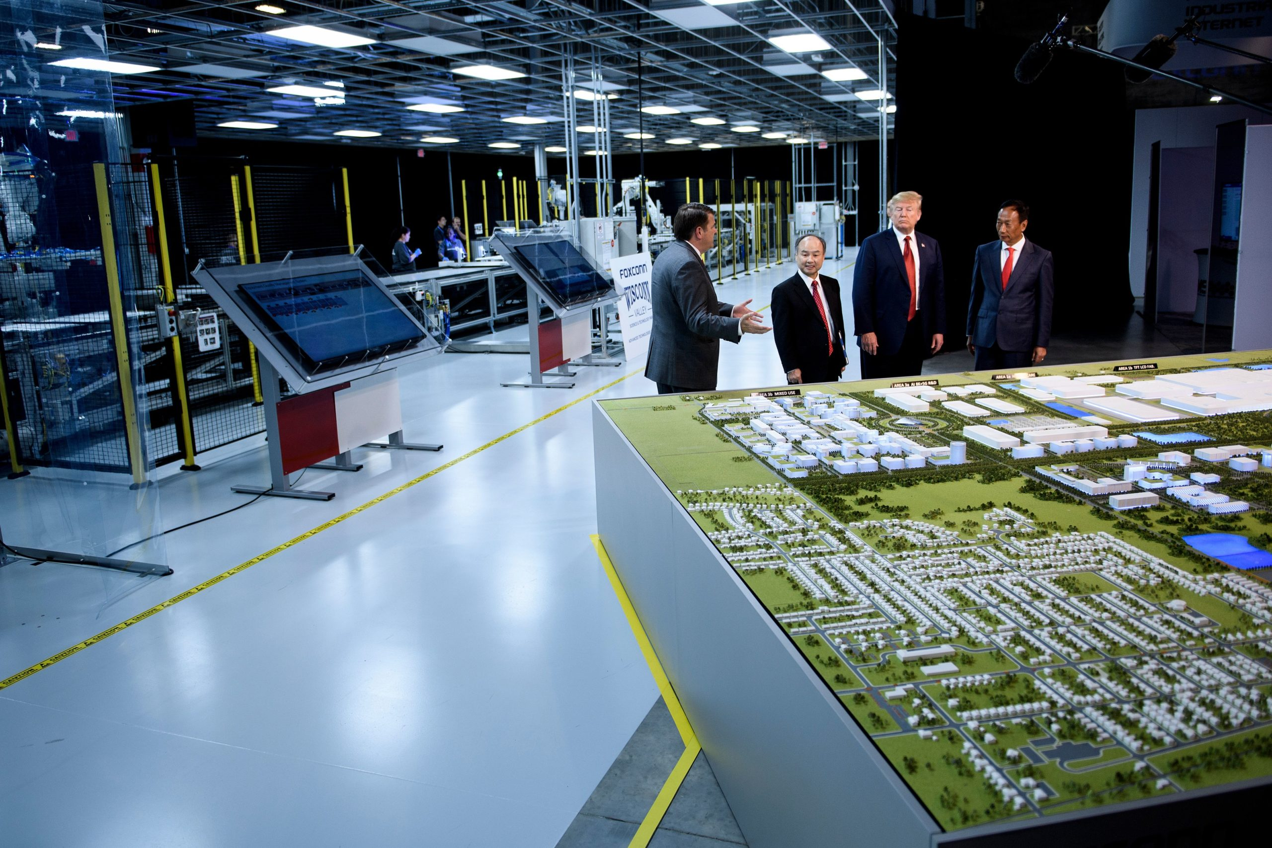 Former President Donald Trump and former Foxconn Chairman Terry Gou tour a Foxconn facility at the Wisconsin Valley Science and Technology Park on June 28, 2018 in Mount Pleasant, Wisconsin. (Brendan Smialowski/AFP via Getty Images)