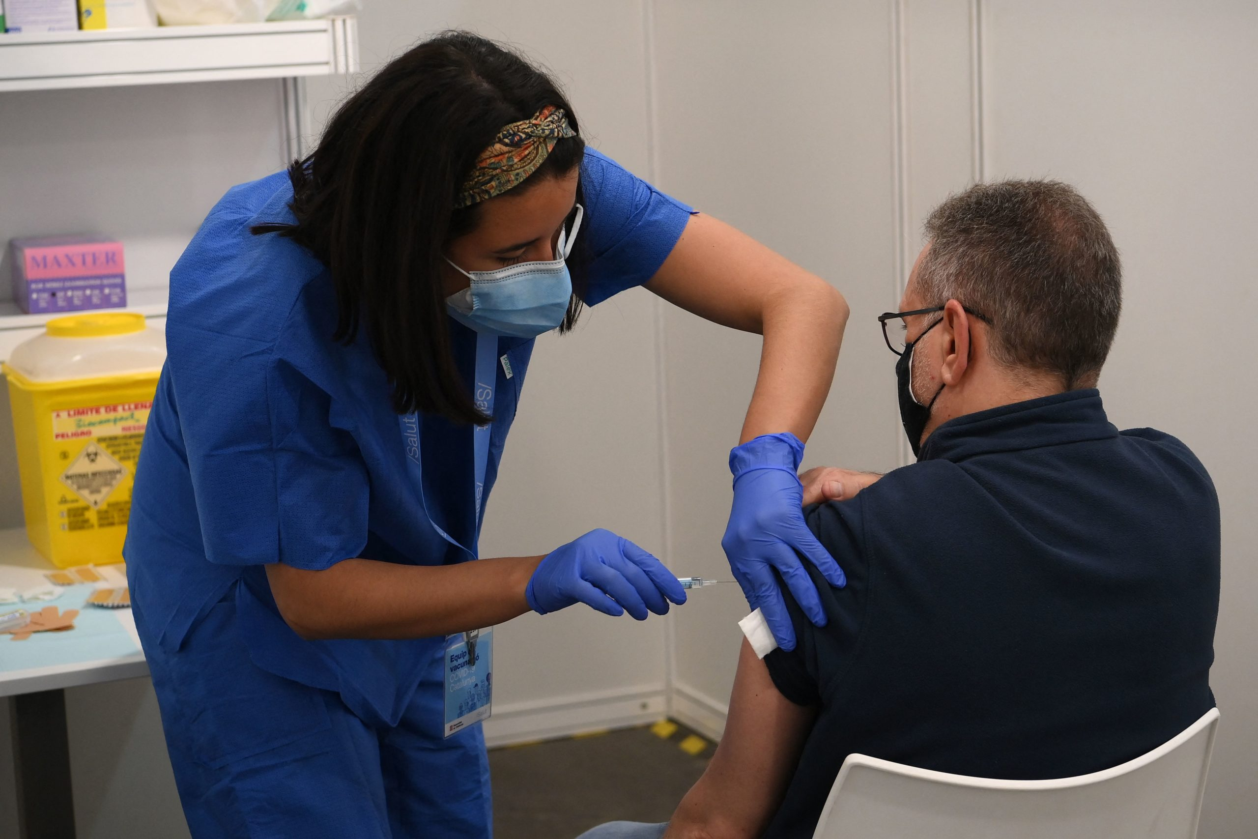A man receives a dose of the AstraZeneca's Covid-19 vaccine at a vaccination center on April 26, 2021 in Barcelona amid a campaign of vaccination to fight the spread of coronavirus. (Photo by LLUIS GENE / AFP) (Photo by LLUIS GENE/AFP via Getty Images)