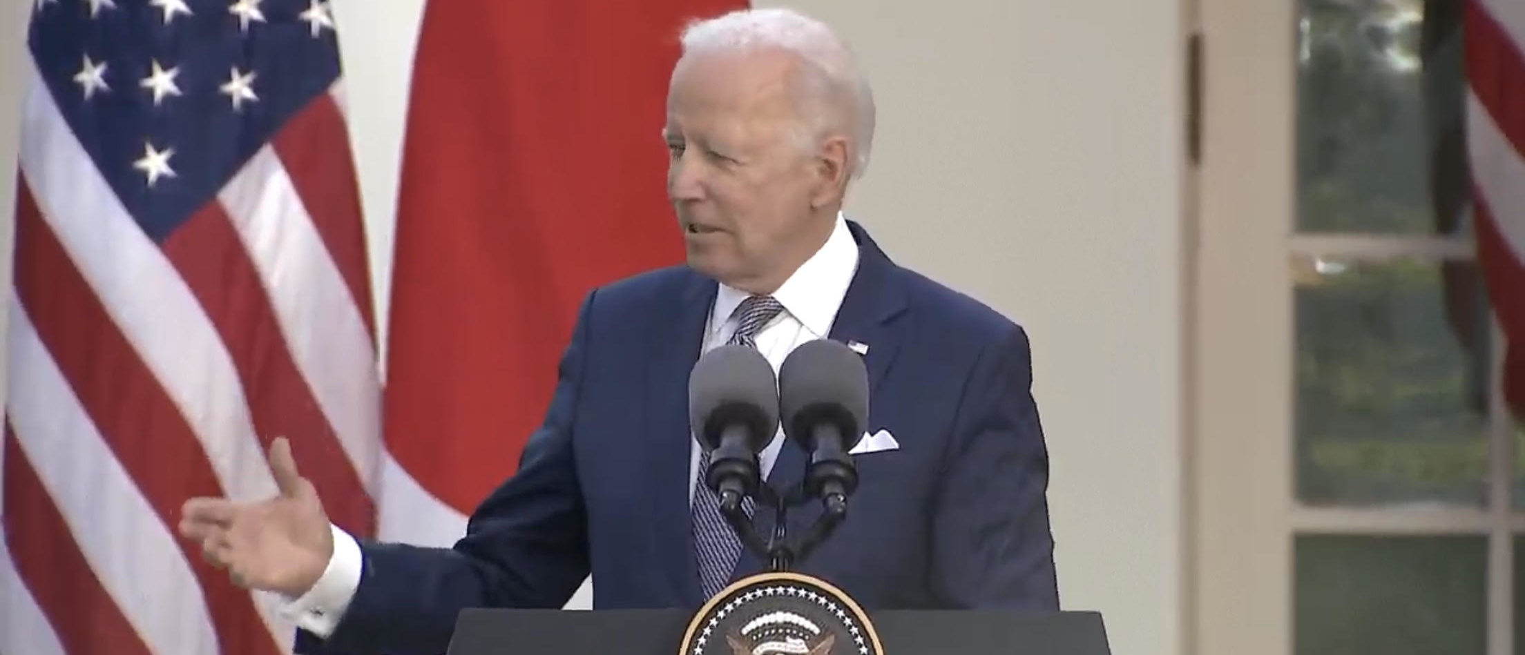 Biden, Japan's Yoshihide Condemn 'Increase In Anti-Asian Discrimination' In US