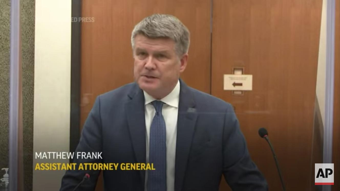Prosecutor Matthew Frank plays a video for Los Angeles Police Department sergeant Jody Stiger. (Screenshot/The Associated Press)